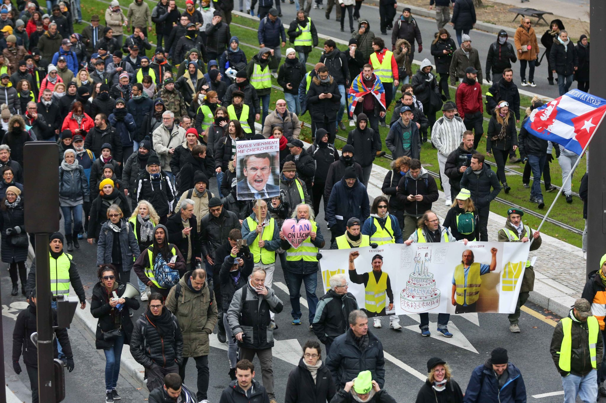 "Members of the ""yellow vest"" (gilets jaunes) movement demonstrate in Paris on November 16, 2019, to celebrate the first anniversary of the movement. French ""yellow vest"" protesters are planning a series of nationwide demonstrations this weekend in a bid to"