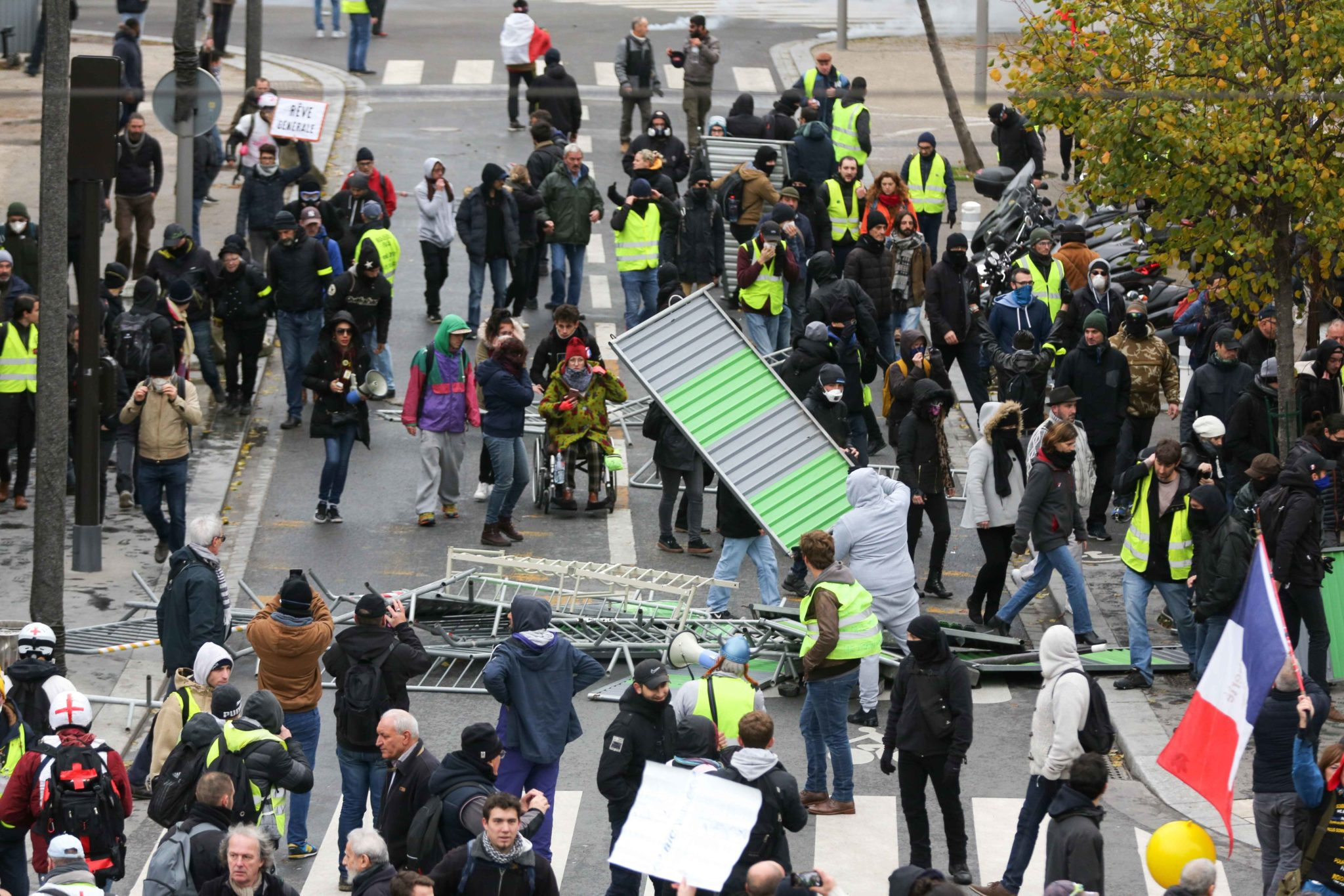 "Members of the ""yellow vest"" (gilets jaunes) movement threw up a barricade in Paris on November 16, 2019, during a demonstration to celebrate the first anniversary of the movement. French ""yellow vest"" protesters are planning a series of nationwide demonst"