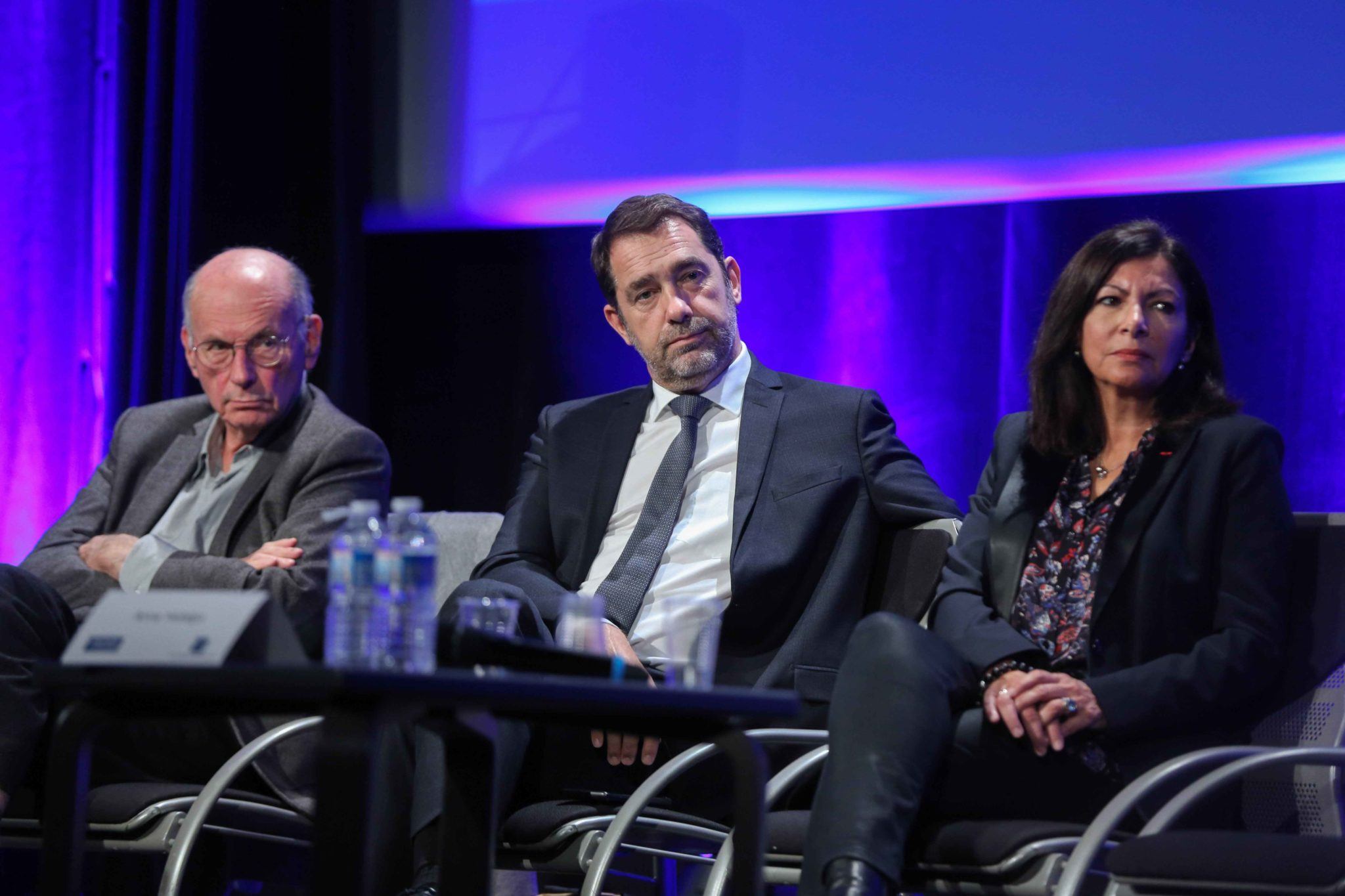 "French Interior Minister Christophe Castaner (C), Paris' mayor Anne Hidalgo (R), President of the Commission on ""the child's first 1000 days"" (les 1000 premiers jours de l'enfant) French neuropsychiatrist  Boris Cyrulnik (L) take part in the 10th national"