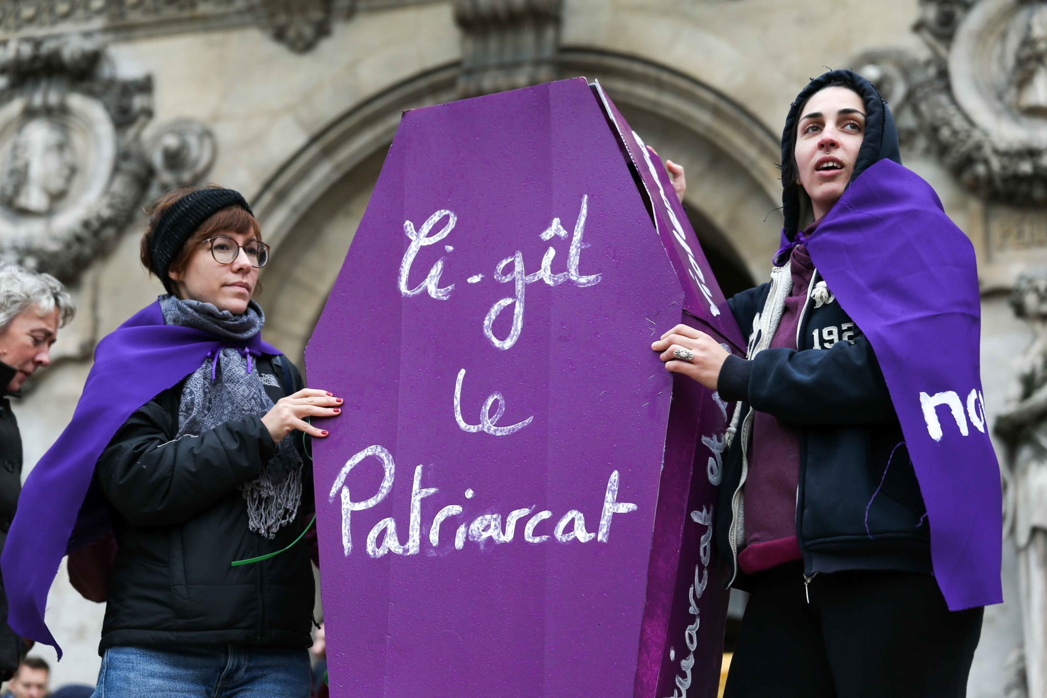 Women hold a purple coffin reading « Here lies patriarcat » during a protest to condemn violence against women, on November 23, 2019, in Paris, in front of the Garnier Opera House. Wearing purple – the adopted colour of feminist struggles – activists