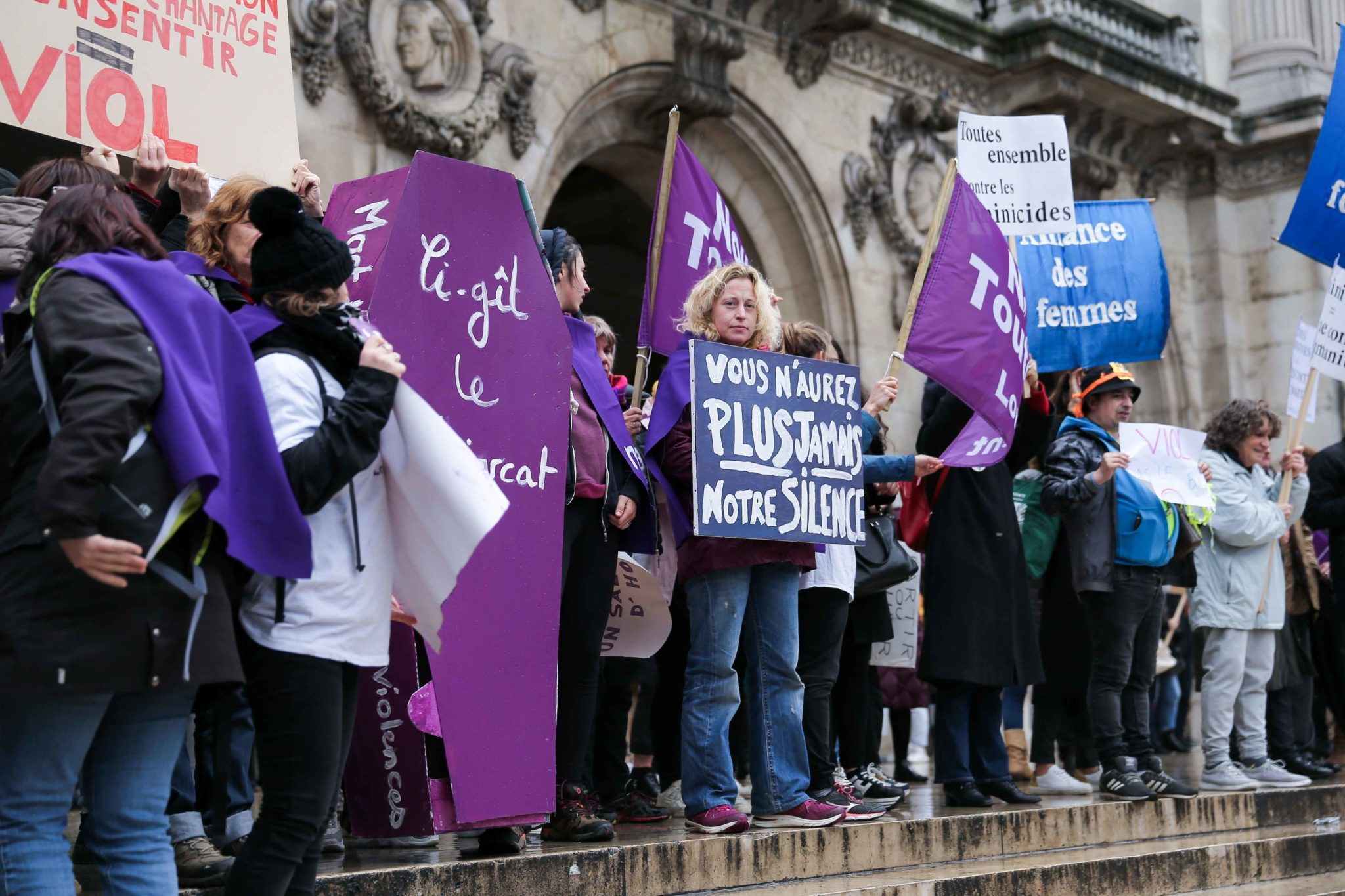 Women hold a purple coffin, flags and signs during a protest to condemn violence against women, on November 23, 2019, in Paris, in front of the Garnier Opera House. Wearing purple – the adopted colour of feminist struggles – activists are taking to the
