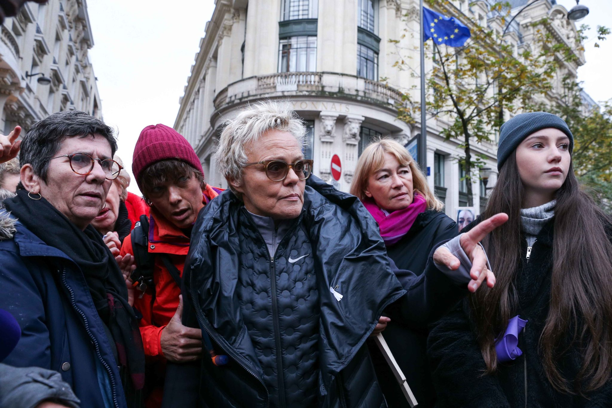 French humorist and activist Muriel Robin (C) takes part in a protest to condemn violence against women, on November 23, 2019, in Paris. Wearing purple – the adopted colour of feminist struggles – activists are taking to the streets of Paris and other