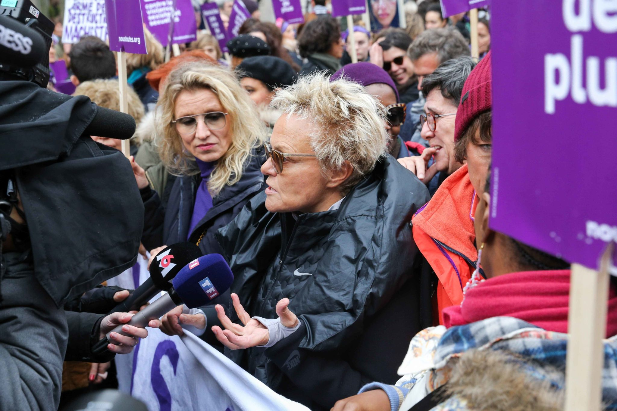 French actress Alexandra Lamy (1L) and French humorist and activist Muriel Robin (C) take part in a protest to condemn violence against women, on November 23, 2019, in Paris. Wearing purple – the adopted colour of feminist struggles – activists are tak