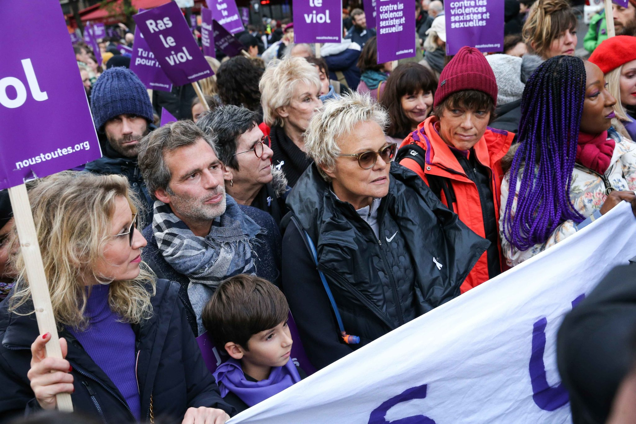 French actress Alexandra Lamy (1L) and French humorist and activist Muriel Robin (3R) take part in a protest to condemn violence against women, on November 23, 2019, in Paris. Wearing purple – the adopted colour of feminist struggles – activists are ta