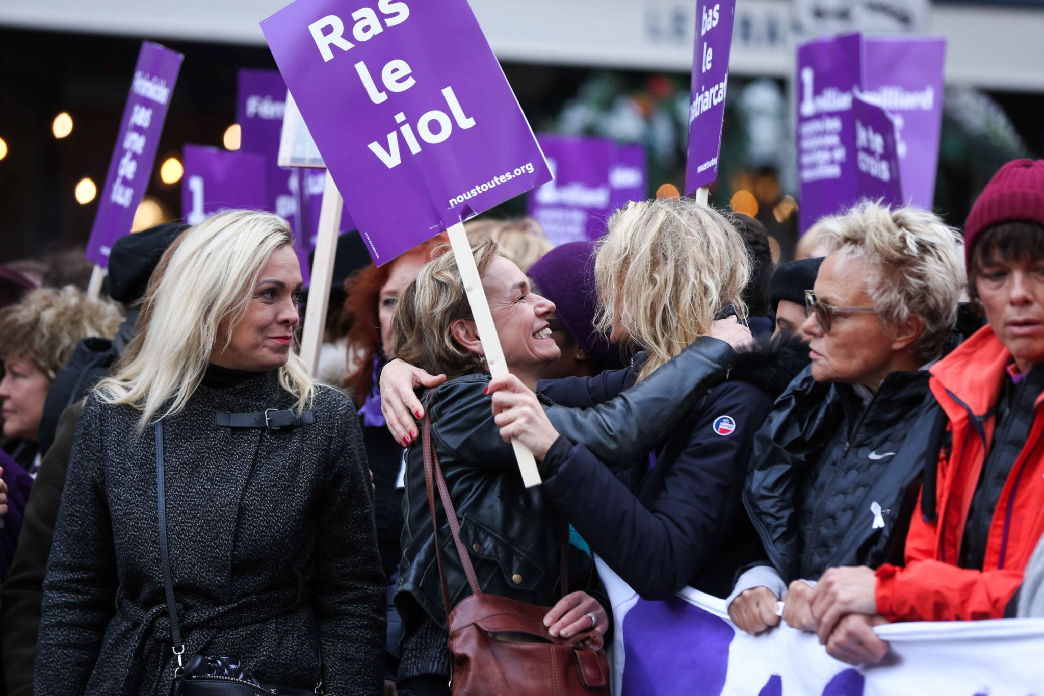 French actresses Sandrine Bonnaire  (4R) and Alexandra Lamy (3R) and French humorist and activist Muriel Robin (2R) take part in a protest to condemn violence against women, on November 23, 2019, in Paris. Wearing purple – the adopted colour of feminist