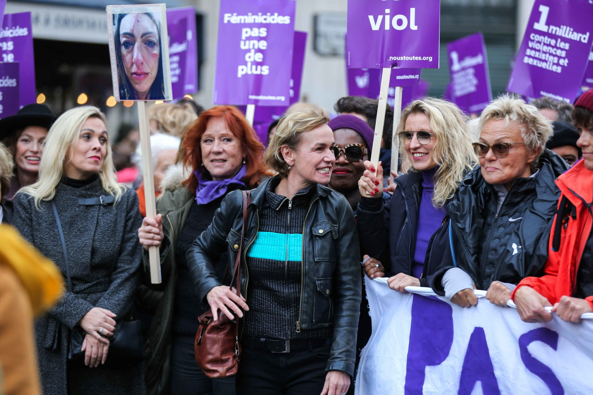 French actresses Sandrine Bonnaire  (3R) and Alexandra Lamy (2R) and French humorist and activist Muriel Robin (1R) take part in a protest to condemn violence against women, on November 23, 2019, in Paris. Wearing purple – the adopted colour of feminist