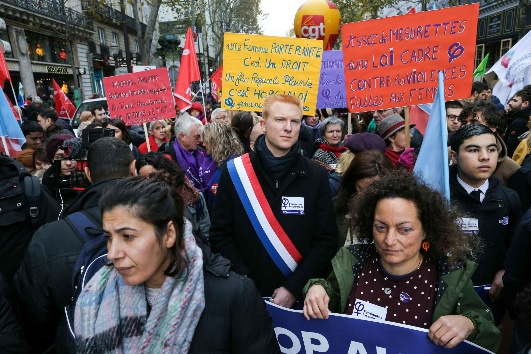 French leftist party La France Insoumise (LFI) deputy Adrien Quatennens (C) takes part in a protest to condemn violence against women, on November 23, 2019, in Paris. Wearing purple – the adopted colour of feminist struggles – activists are taking to t