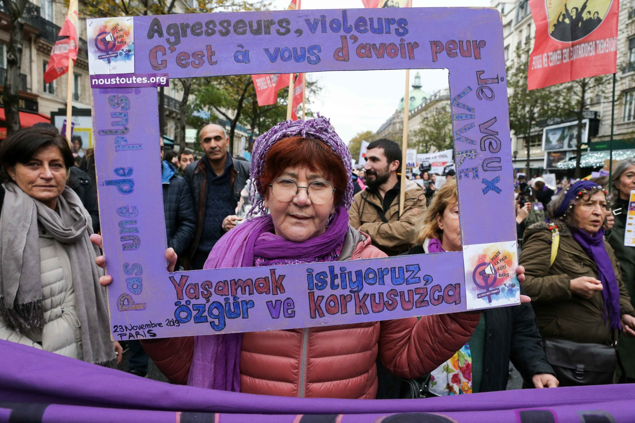 A women holds a purple placard during a protest to condemn violence against women, on November 23, 2019, in Paris, in front of the Garnier Opera House. Wearing purple – the adopted colour of feminist struggles – activists are taking to the streets of P
