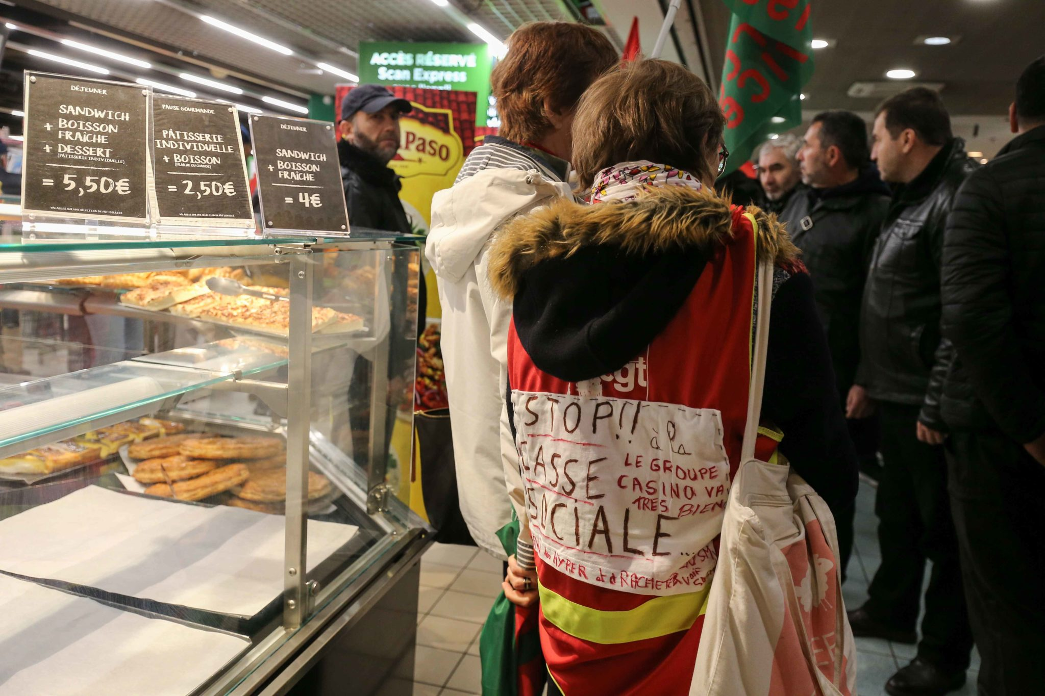 French General Confederation of Labour (CGT) union members demonstrate inside Casino supermarket in the 13th arrondissement of Paris on November 26, 2019, against the deterioration in working conditions and the take over by the German group Aldi of 700 Lea