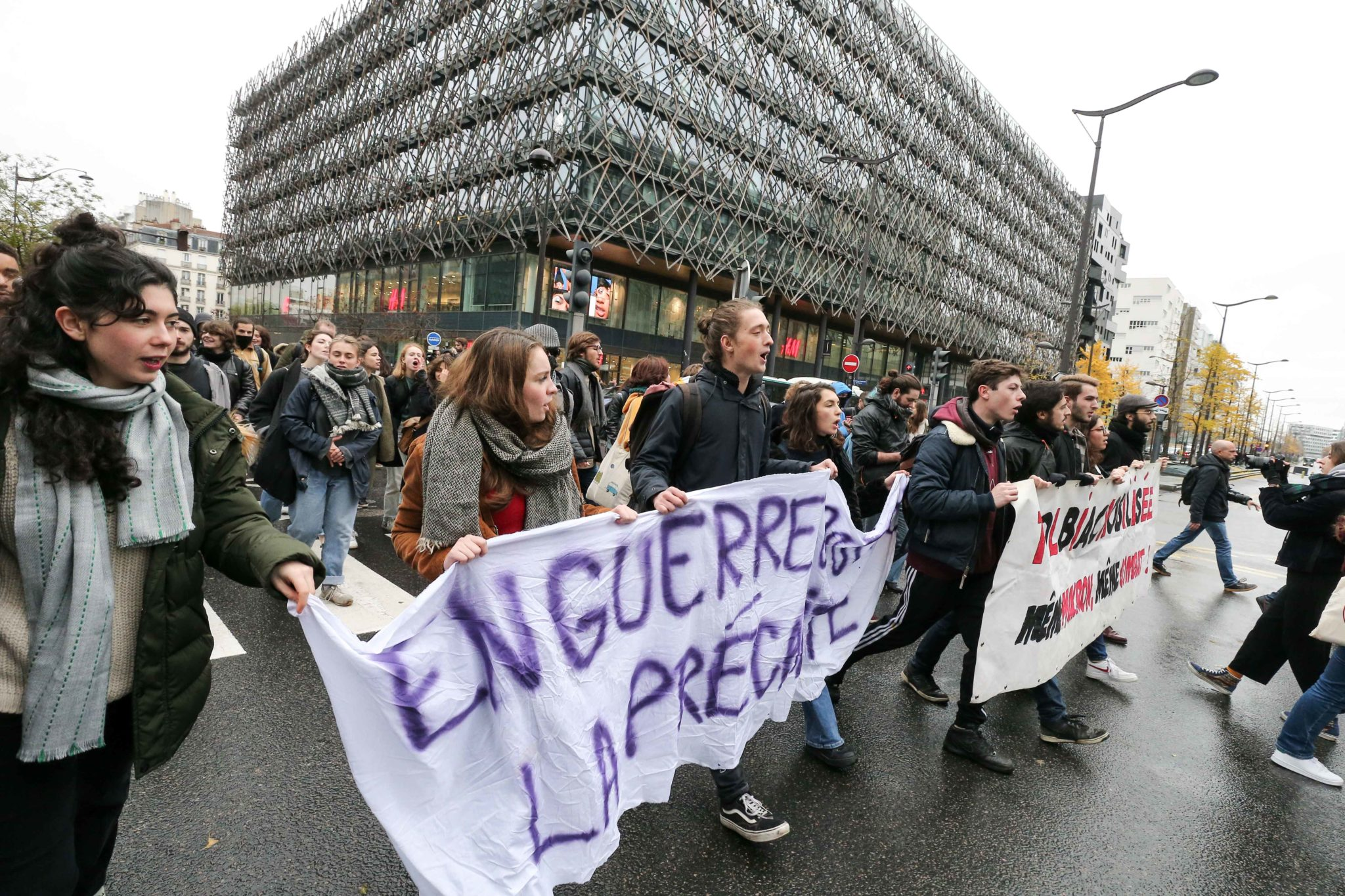 French students hold  banners reading « At war against precariousness » and « Tolbiac mobilized » as they demonstrate against their precariousness near the University of Paris-1 Tolbiac, on November 26, 2019, after the suicide attempt of a 22-year-old