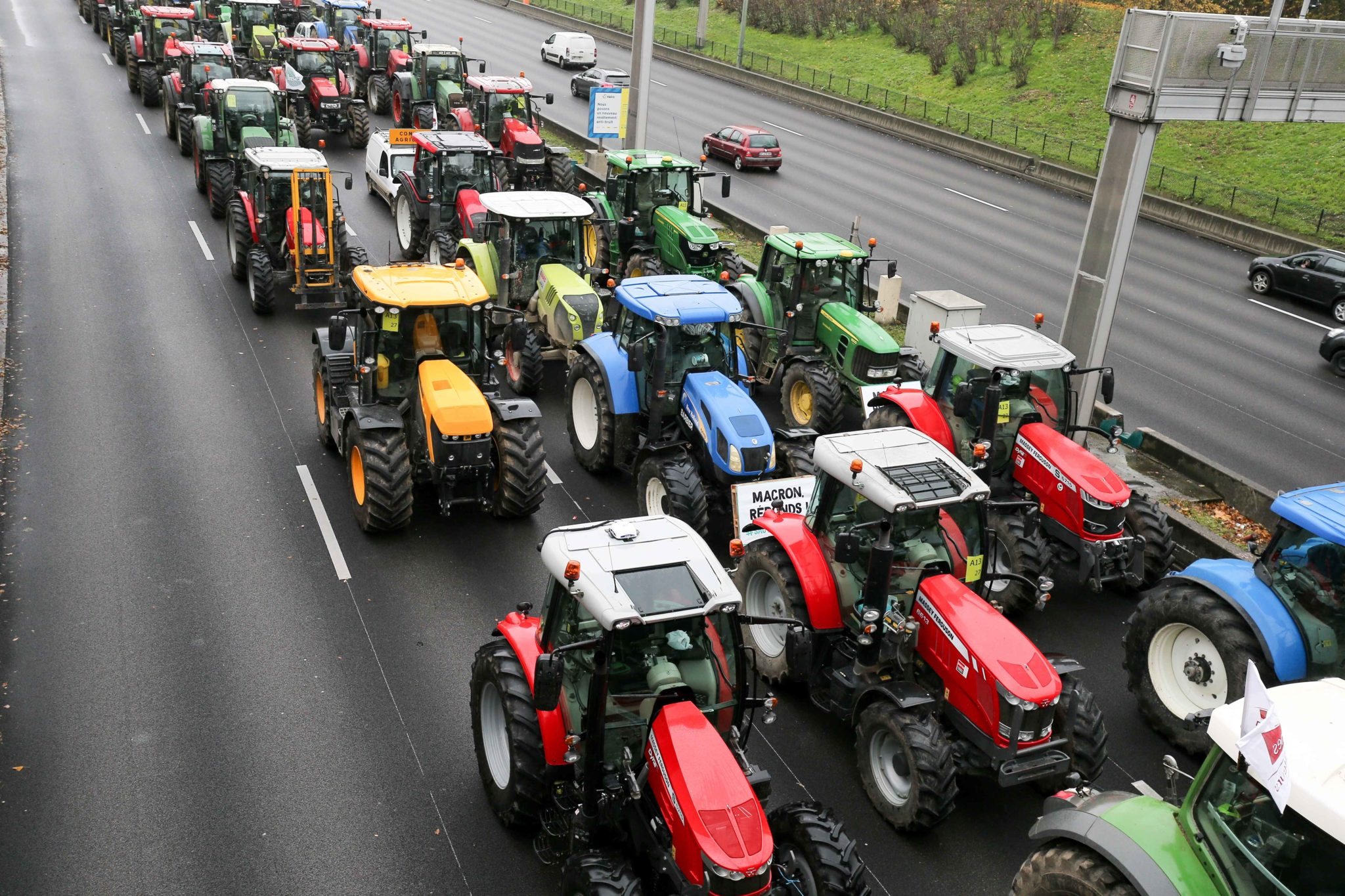 French farmers steer their tractors on The Parisian ring road (Peripherique) at Porte Dauphine in Paris on November 27, 2019, during a protest against government policies. Hundreds of French farmers descended on Paris by tractor to protest the struggles of