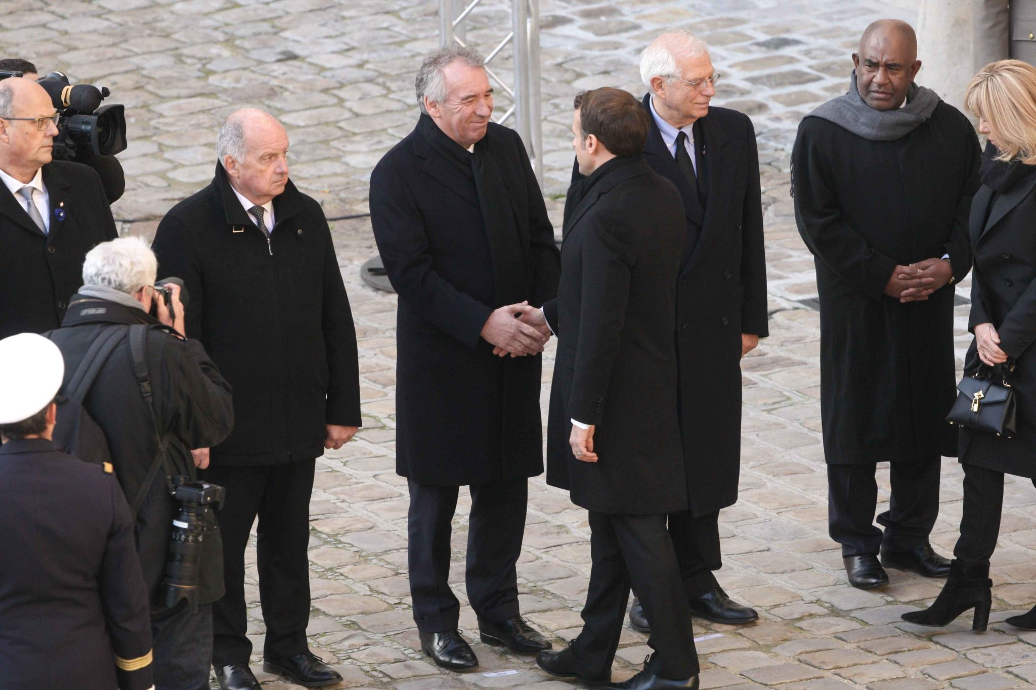 France's President Emmanuel Macron (4R) shakes hand with Mayor of Pau, Francois Bayrou (5R) during a tribute ceremony on December 2, 2019 at the Invalides monument, in Paris, for the 13 French soldiers killed in Mali. In its biggest military funeral in dec