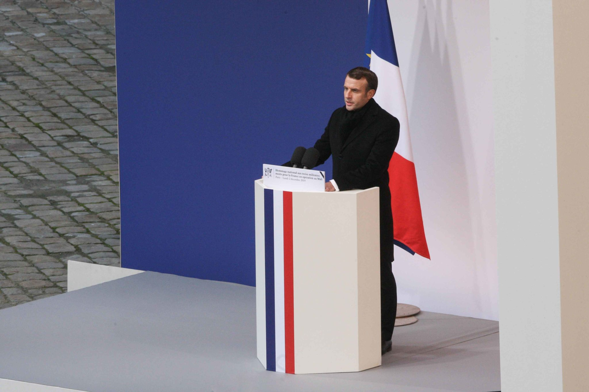France's President Emmanuel Macron speaks during a tribute ceremony on December 2, 2019 at the Invalides monument, in Paris, for the 13 French soldiers killed in Mali. In its biggest military funeral in decades, France is honoring 13 soldiers killed when t