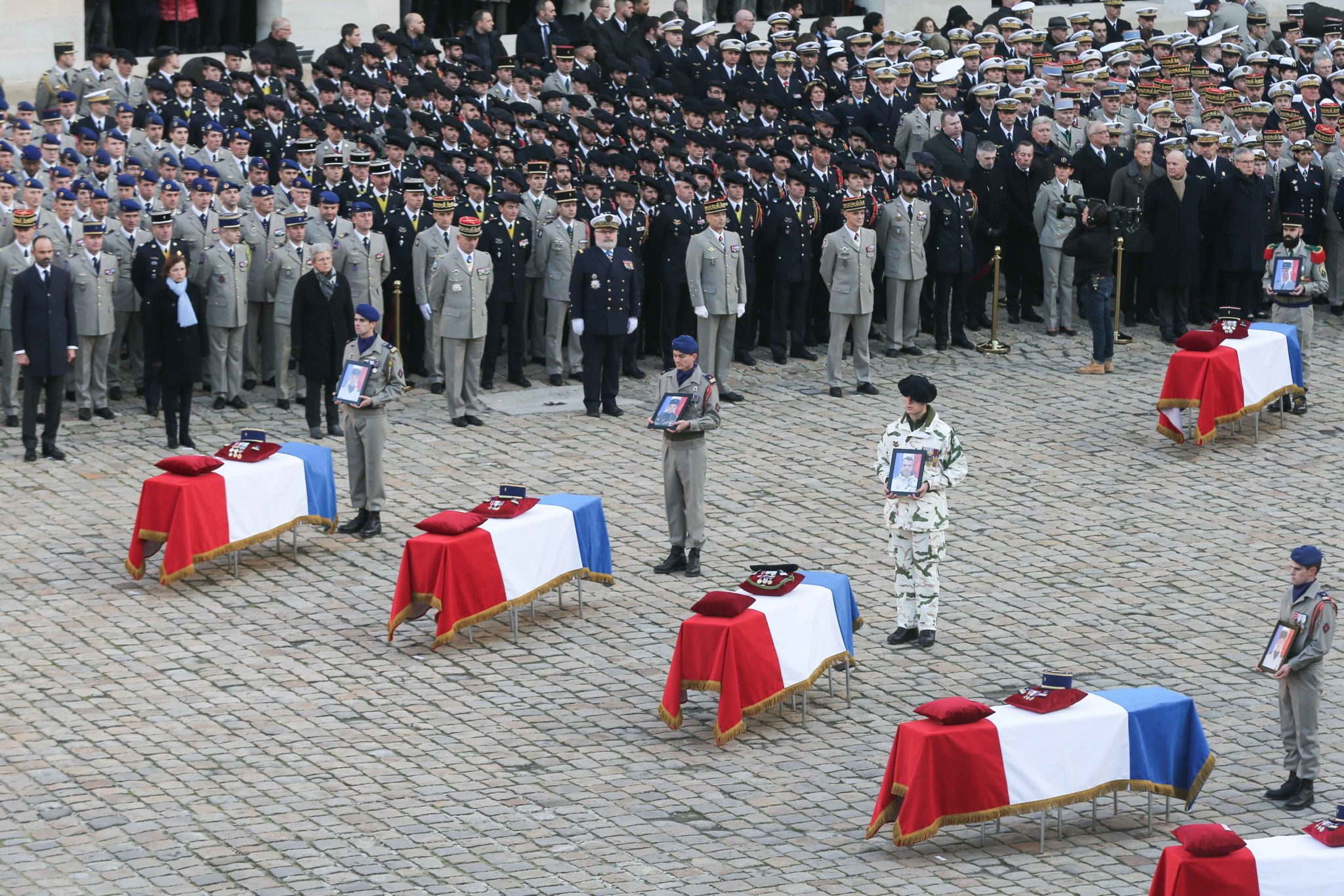 Soldiers, officials and relatives attend a tribute ceremony on December 2, 2019 at the Invalides monument, in Paris, for the 13 French soldiers killed in Mali. In its biggest military funeral in decades, France is honoring 13 soldiers killed when their hel