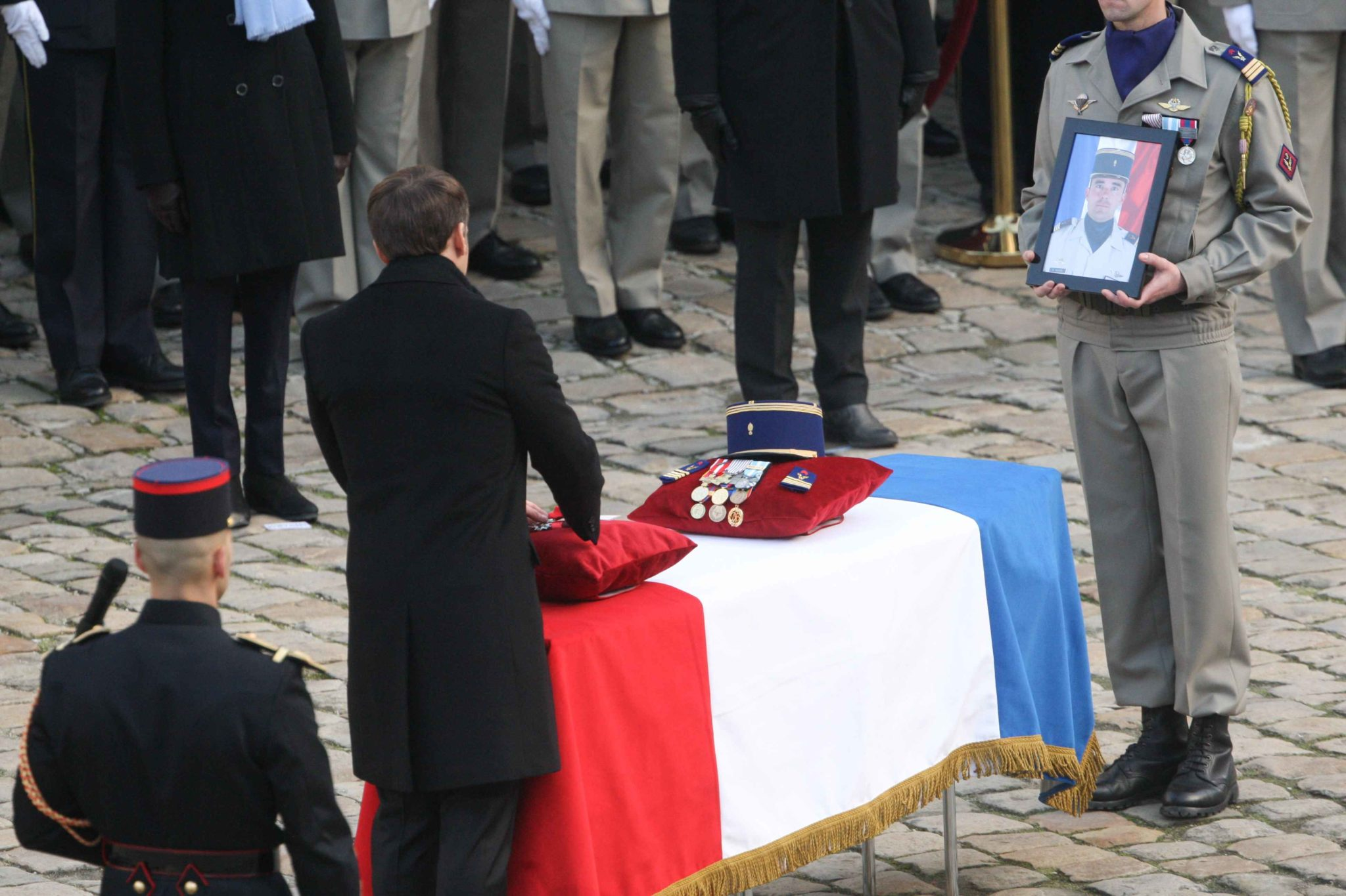 French President Emmanuel Macron posthumously awards a soldier with the Legion of Honor during a tribute ceremony on December 2, 2019 at the Invalides monument, in Paris, for the 13 French soldiers killed in Mali. In its biggest military funeral in decades