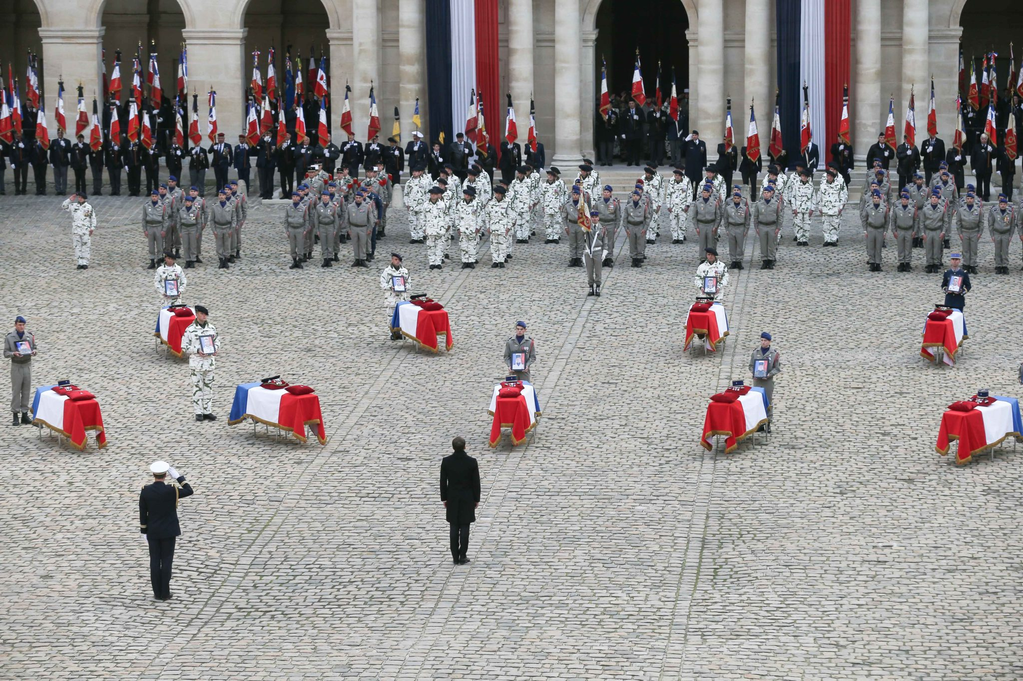 France's President Emmanuel Macron stands in front of coffins of the 13 French soldiers killed in Mali during a tribute ceremony on December 2, 2019 at the Invalides monument, in Paris. In its biggest military funeral in decades, France is honoring 13 sold