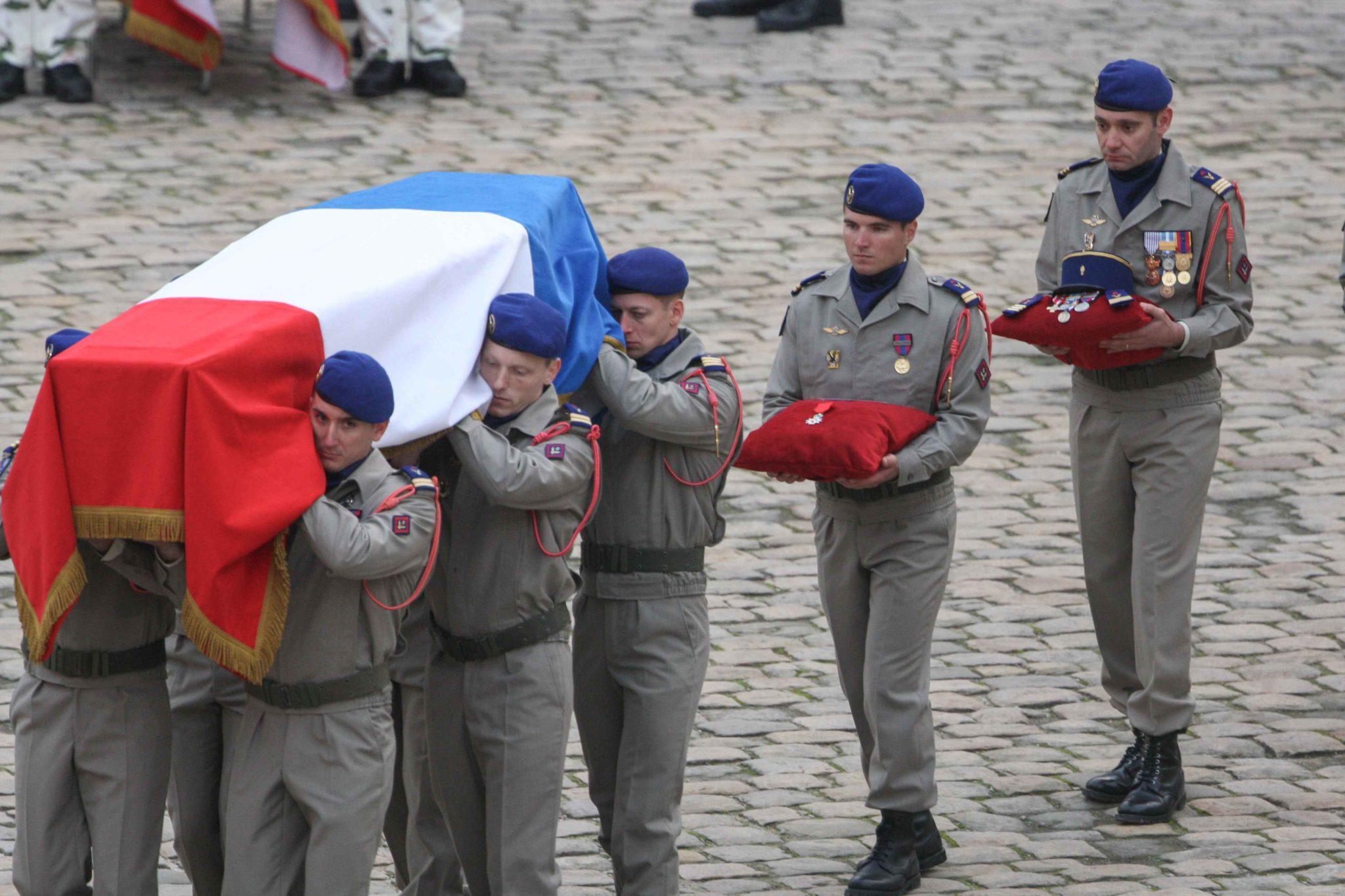 Soldiers carry the coffin of the 13 French soldiers who died in a helicopter collision in Mali during the tribute ceremony at the Invalides monument in Paris on December 2, 2019. In its biggest military funeral in decades, France is honoring 13 soldiers ki