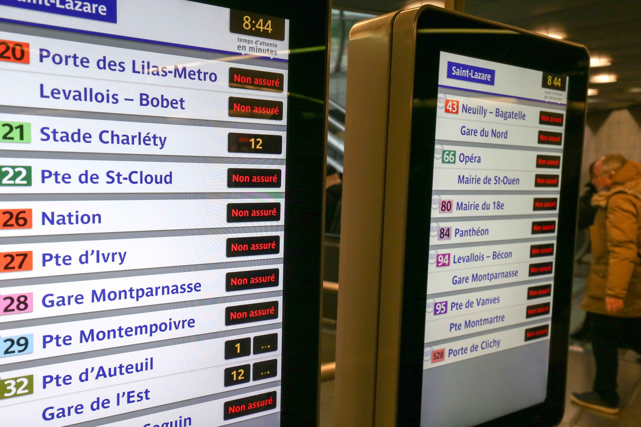 Most trains do not operate as shown on the display panel in Paris Gare Saint-Lazare during a strike of Paris public transports operator RATP and public railways company SNCF employees against French government's plan to overhaul the country's retirement sy