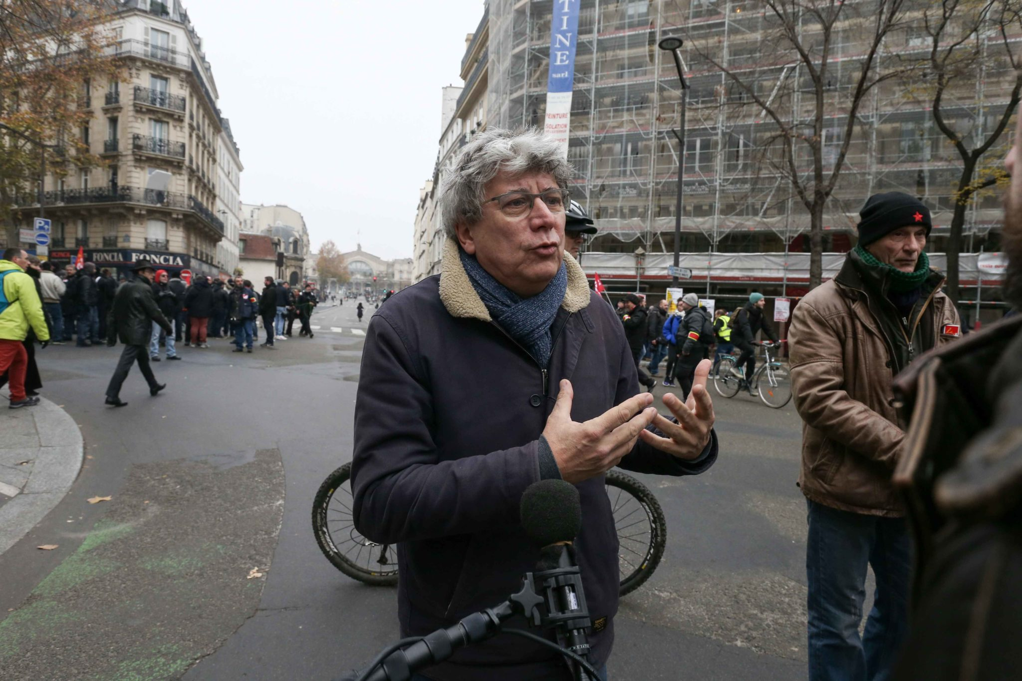 French leftist party La France Insoumise (LFI) deputy Eric Coquerel talks with the press during a demontration to protest against the pension overhauls, in Paris, on December 5, 2019 as part of a national general strike. Trains cancelled, schools closed: F