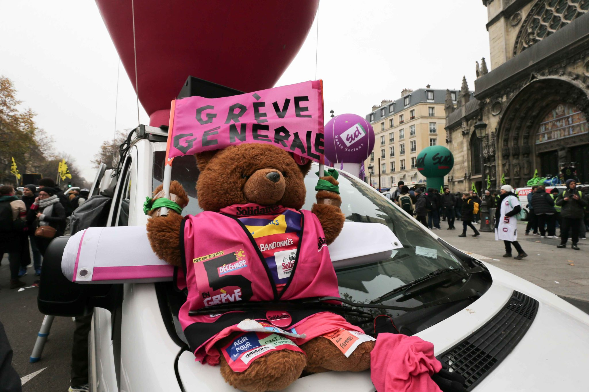 A Teddy Bear bearing the inscription « General strike » is diplayed during a demontration to protest against the pension overhauls, in Paris, on December 5, 2019 as part of a national general strike. Trains cancelled, schools closed: France scrambled to