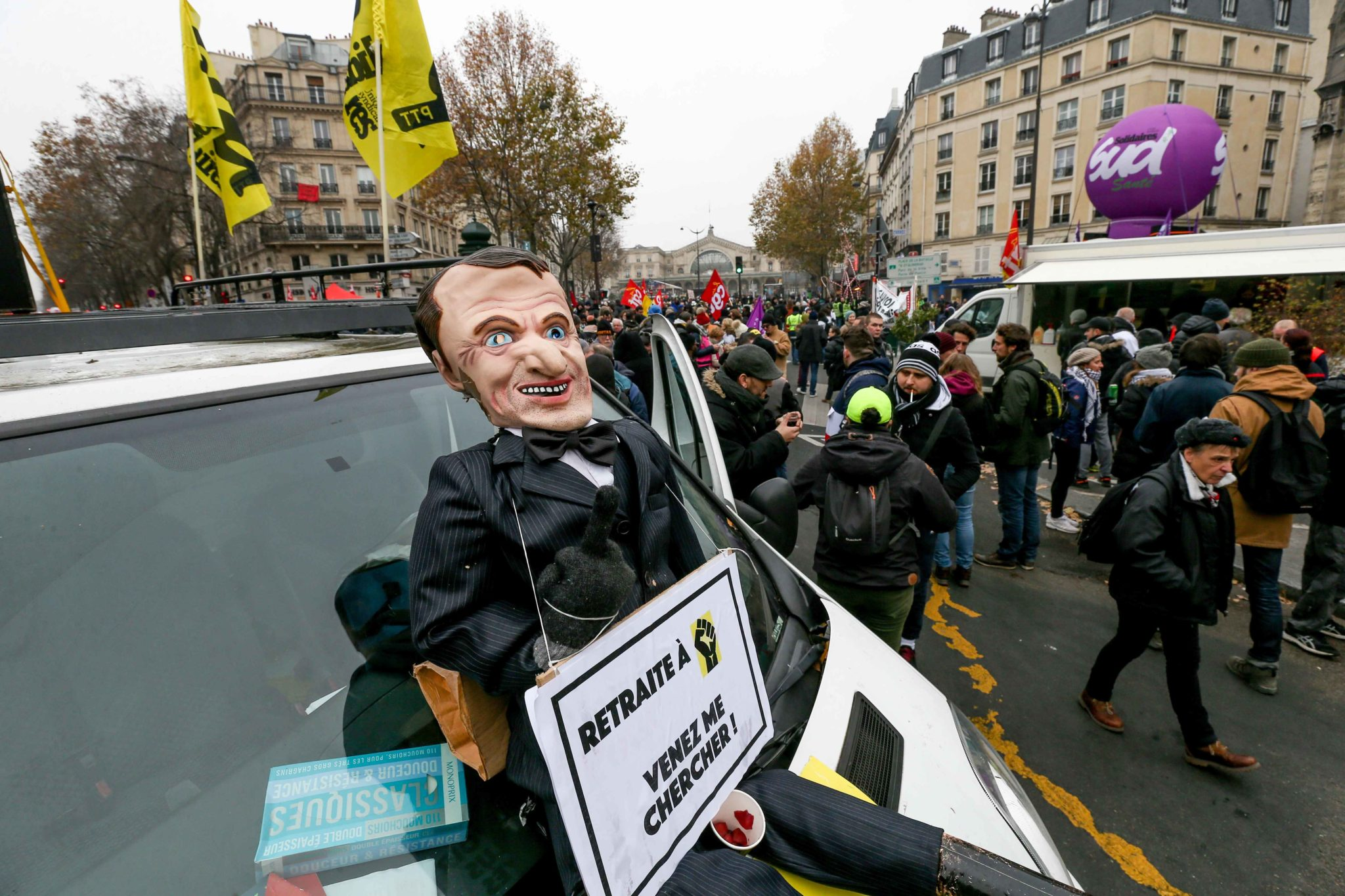 A puppet giving the finger and representing the French President Emmanuel Macron wit the inscription « Come get me » is diplayed during a demontration to protest against the pension overhauls, in Paris, on December 5, 2019 as part of a national general s
