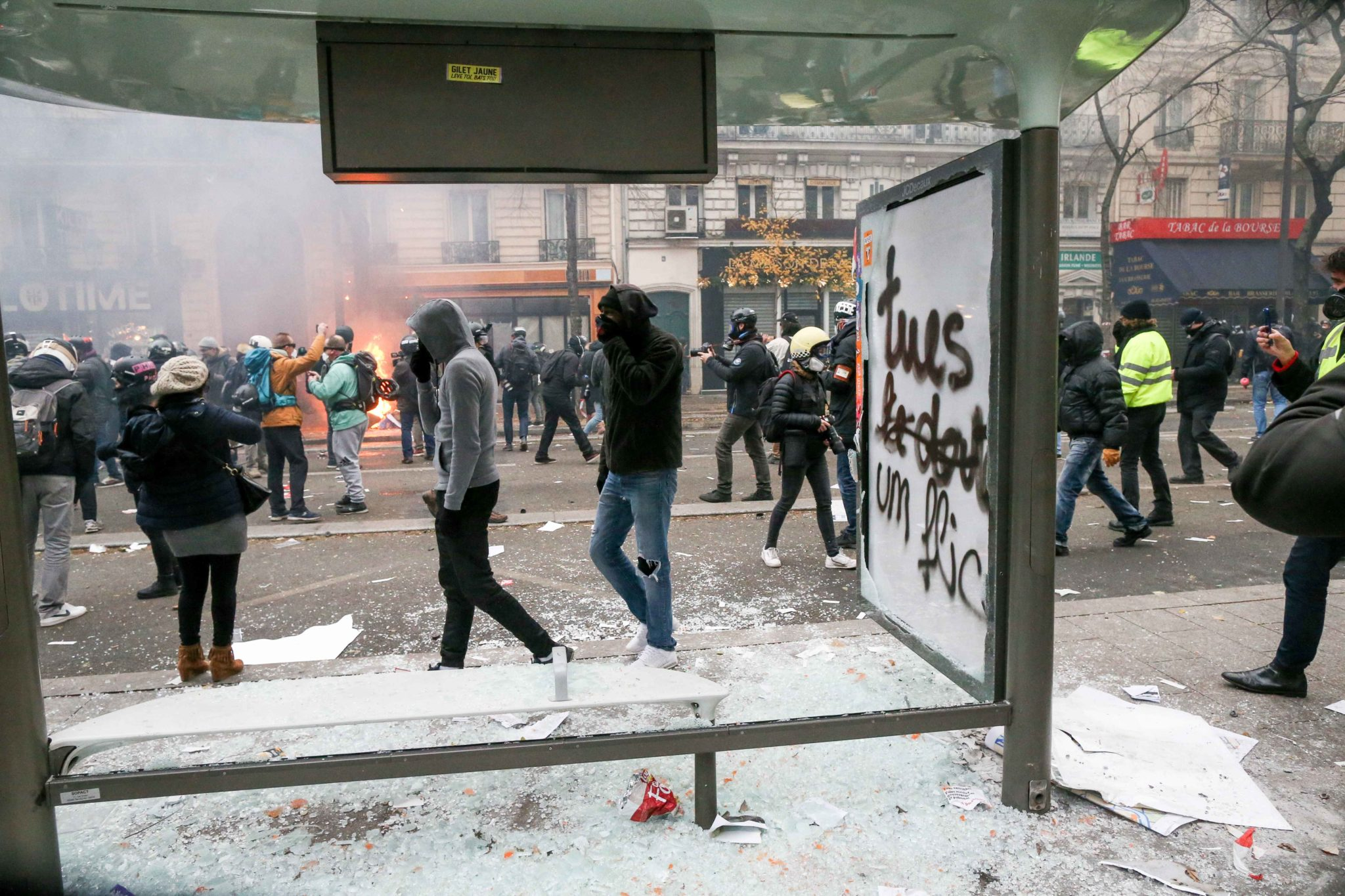 A bus bench is destroyed and tagged with words « Kill a cop » during a demontration to protest against the pension overhauls, in Paris, on December 5, 2019 as part of a national general strike. Trains cancelled, schools closed: France scrambled to make c