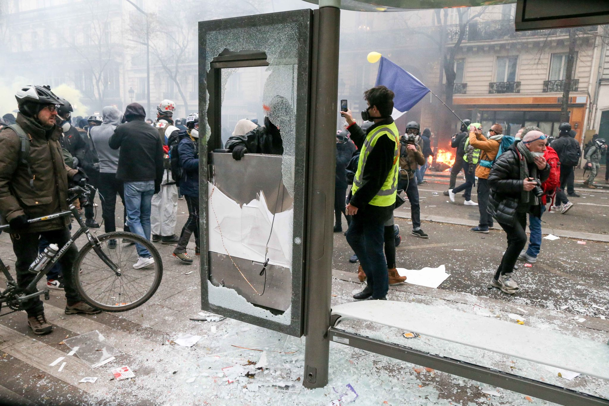 A bus bench is destroyed during a demontration to protest against the pension overhauls, in Paris, on December 5, 2019 as part of a national general strike. Trains cancelled, schools closed: France scrambled to make contingency plans on for a huge strike a