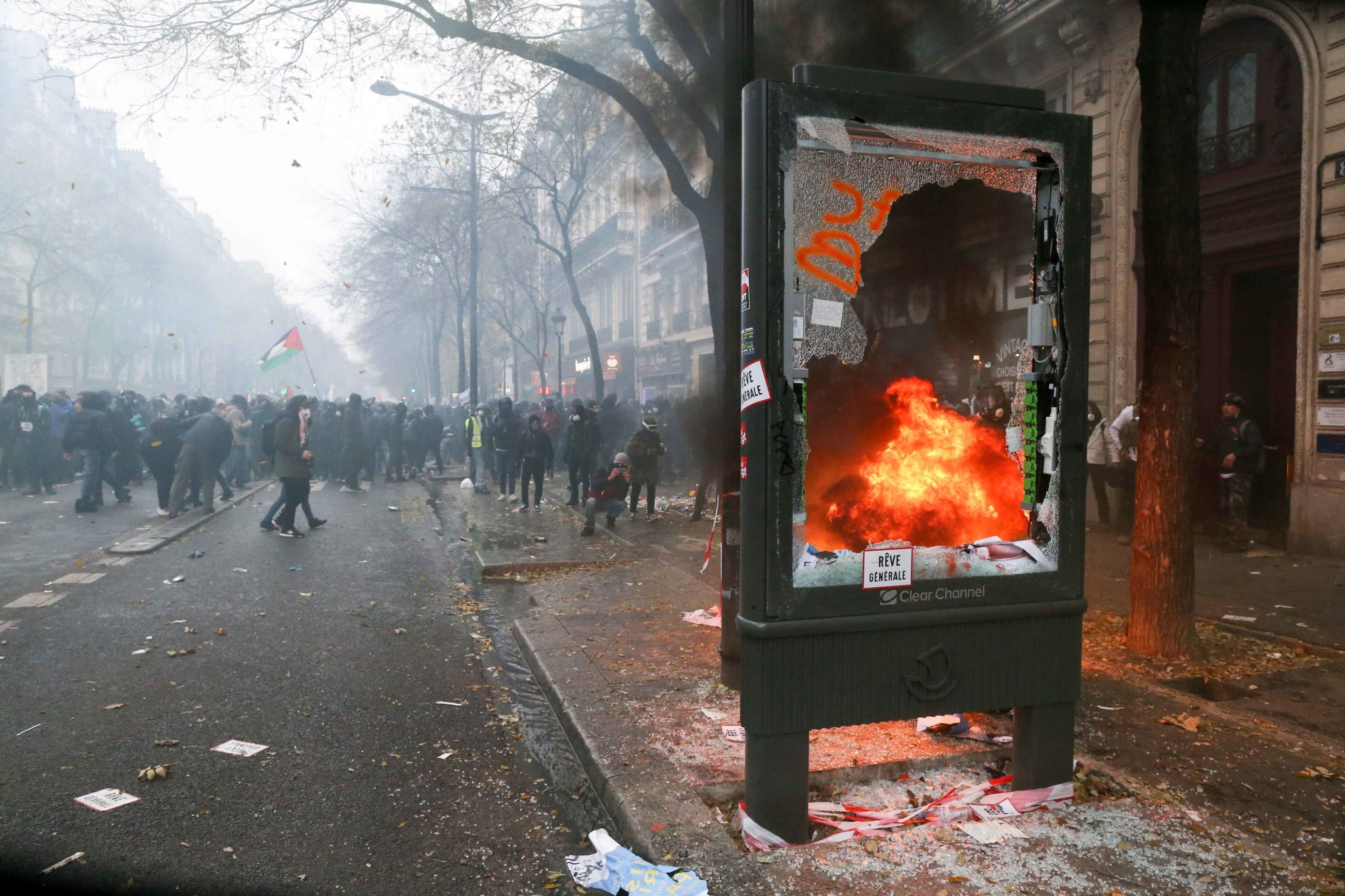 A publicity pane is destroyed during a demontration to protest against the pension overhauls, in Paris, on December 5, 2019 as part of a national general strike. Trains cancelled, schools closed: France scrambled to make contingency plans on for a huge str