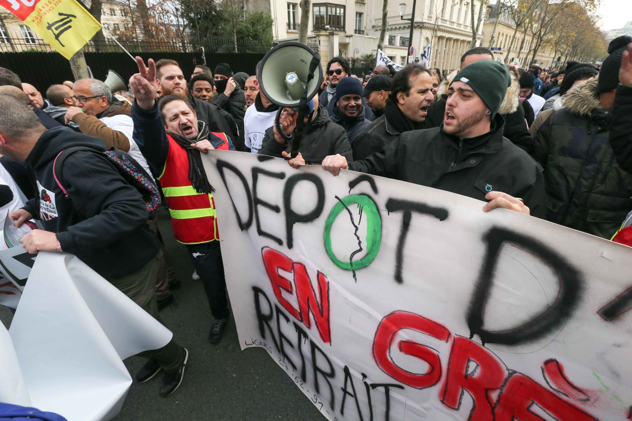 Parisien transport workers march in Paris, on December 10, 2019 on a sixth day of a strike of public transport operators SNCF and RATP employees over French government's plan to overhaul the country's retirement system. Unions have vowed to keep up the fig