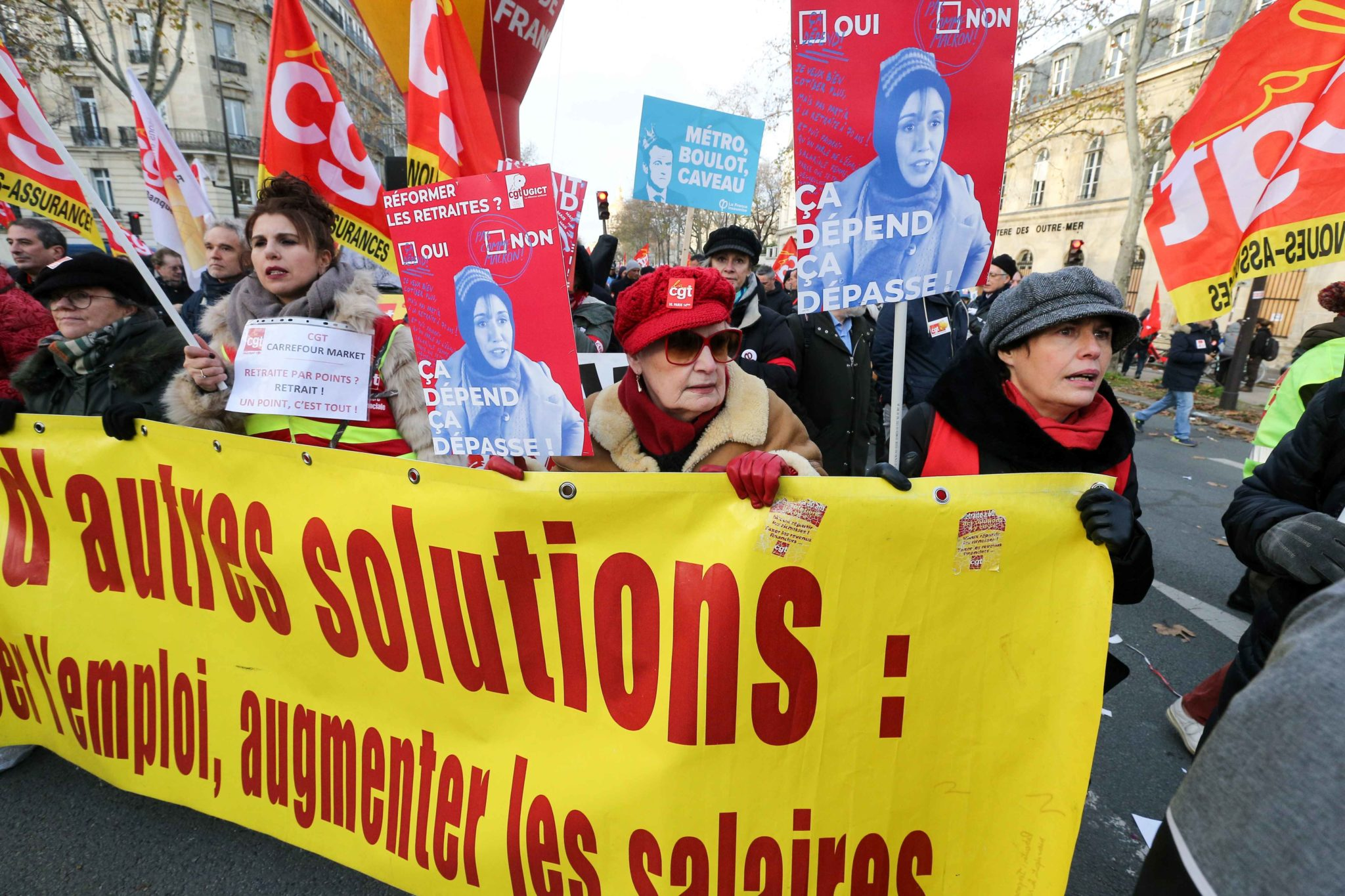 Demonstrators march in Paris, on December 10, 2019 on a sixth day of a strike of public transport operators SNCF and RATP employees over French government's plan to overhaul the country's retirement system. Unions have vowed to keep up the fight over the r