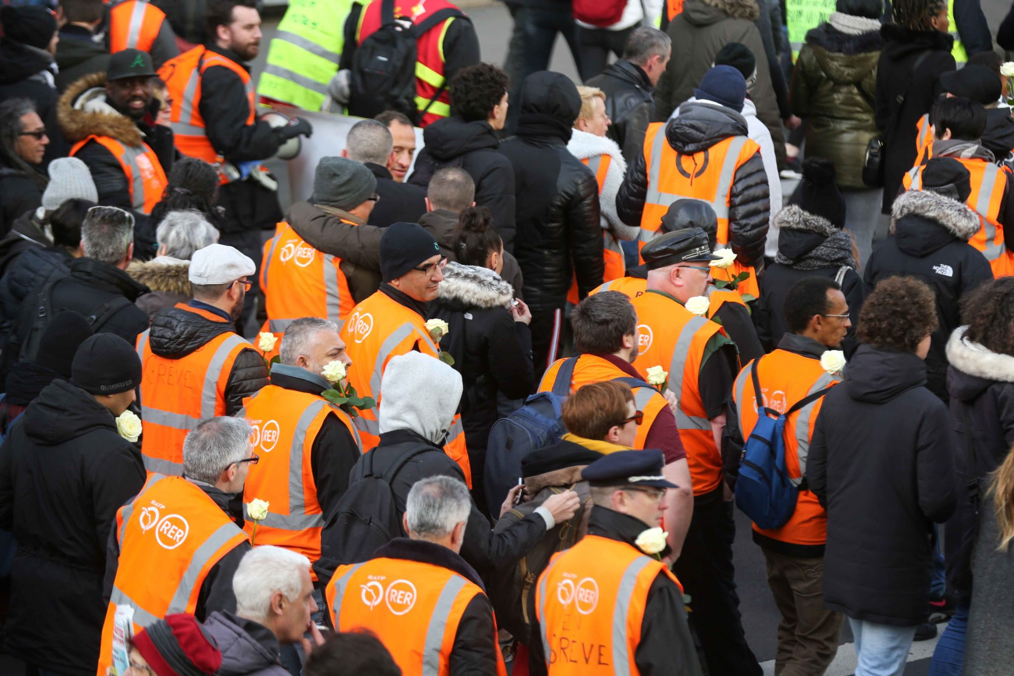 Striking railway workers wearing an orange vest of Paris' RATP public transport operator take to the street during a demonstration called by French national trade union General Confederation of Labour (CGT) against the pension reform on January 4, 2020, in