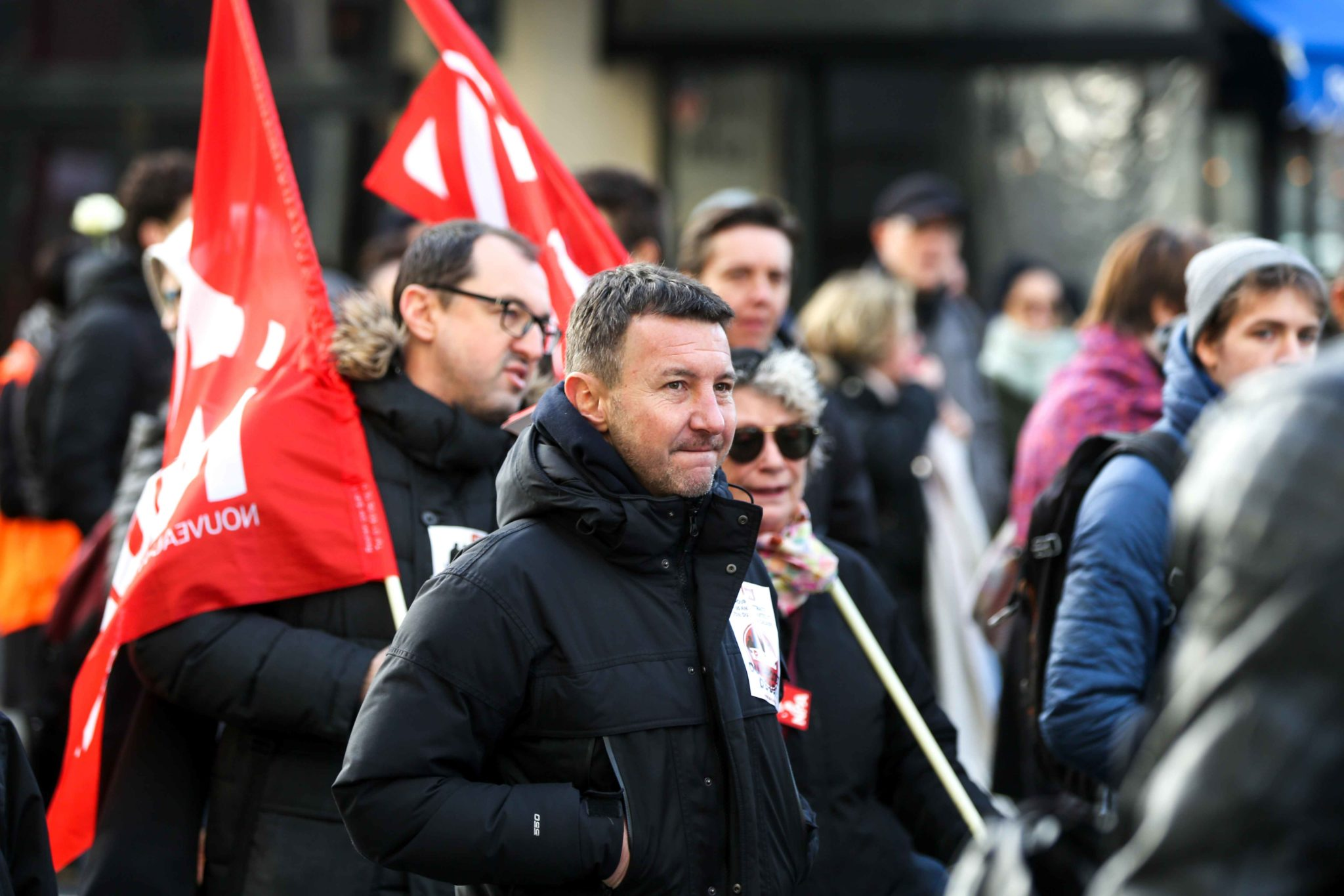 Spokesperson of French far-left party NPA Olivier Besancenot (C) takes part in a demonstration called by French national trade union General Confederation of Labour (CGT) against the pension reform on January 4, 2020, in front of the Gare de Lyon train sta