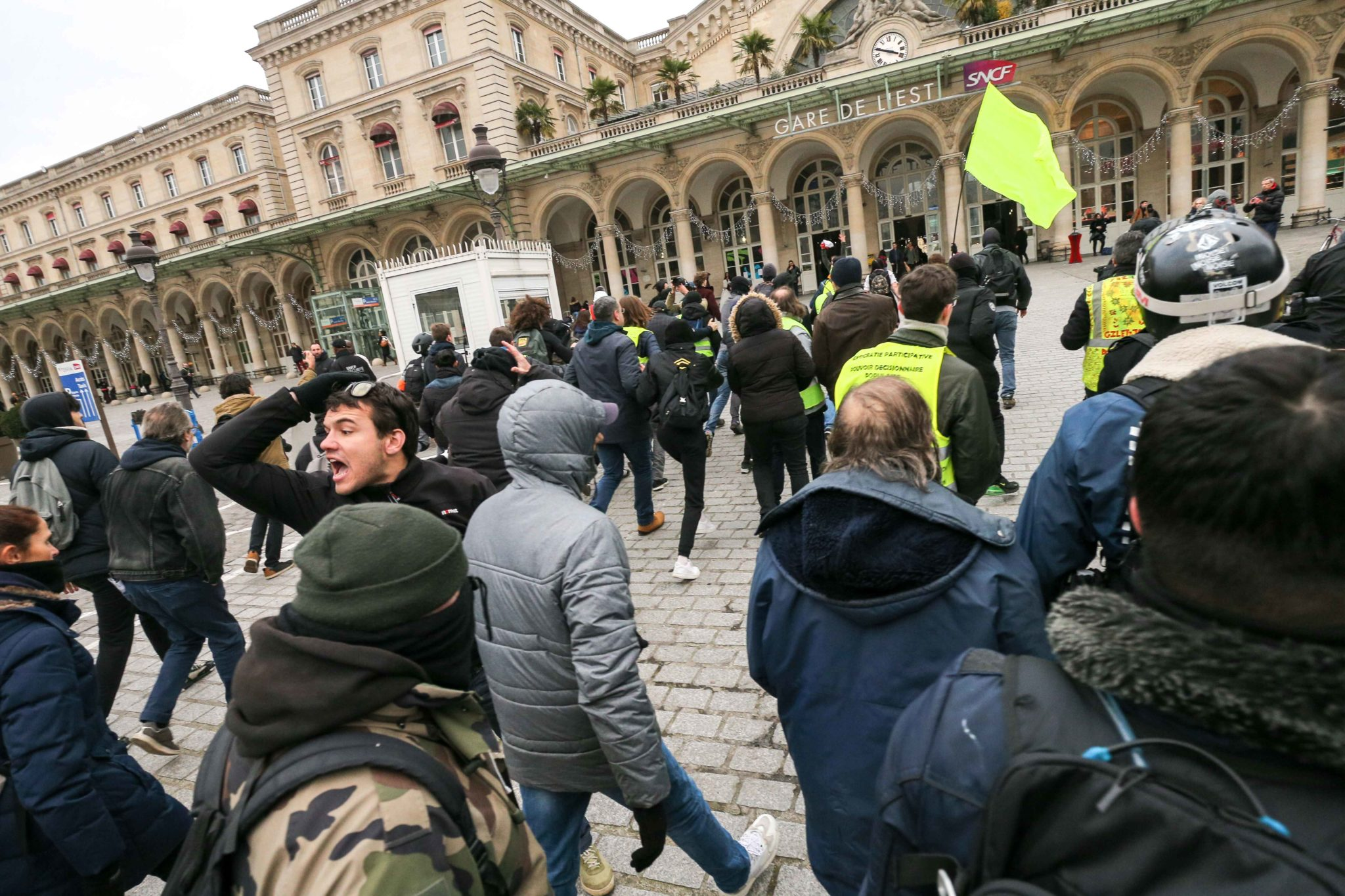 Demonstrators break into the Gare de l'Est train station in Paris during a demonstration called by French national trade union General Confederation of Labour (CGT) against the pension reform on January 4, 2020. After 30 days of strike, unions opposed to