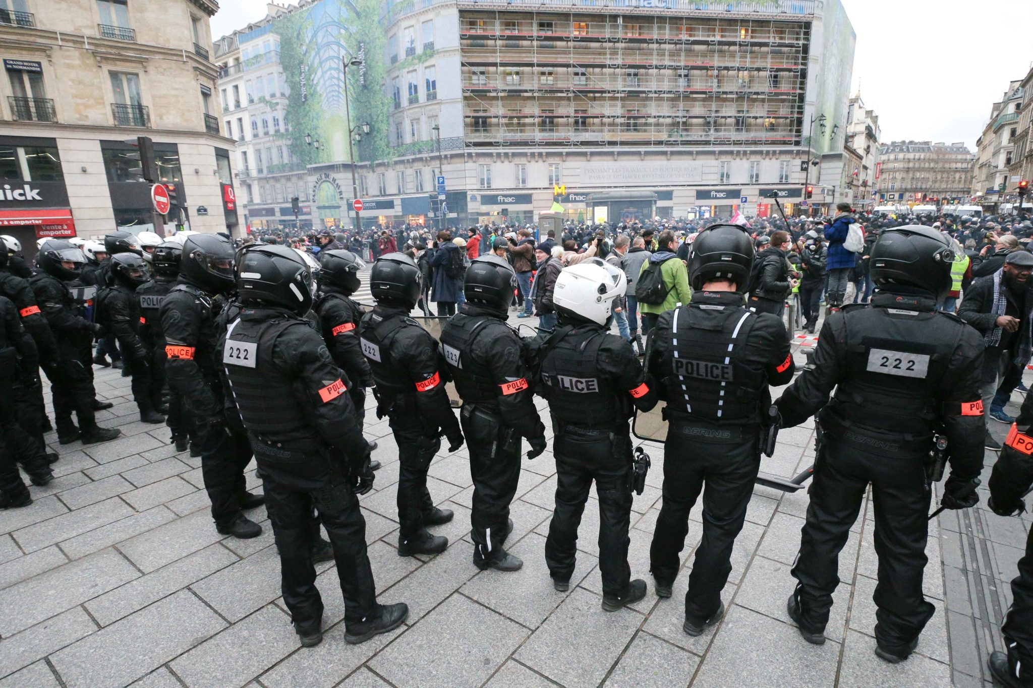 CRS riot policemen stand in front of protesters during a demonstration in Paris, on January 9, 2020, on the 36th day of a nationwide multi-sector strike against French government's pensions overhaul.
