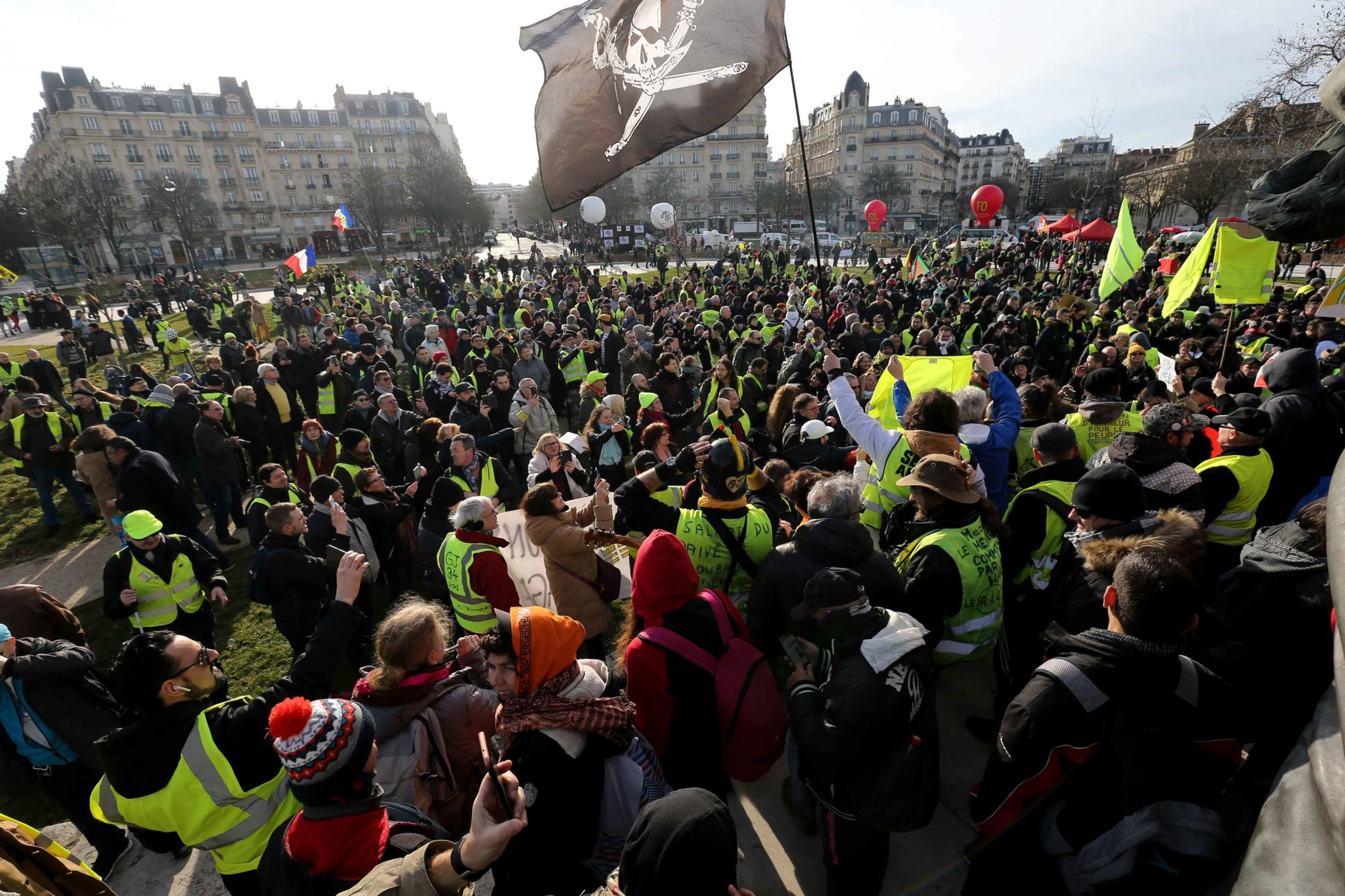 Yellow vests gather in front of the statue of the Nation Square (Place de la Nation) during a demonstration in Paris, on January 11, 2020, as part of a nationwide multi-sector strike against the French government's pensions overhaul. The country has been h