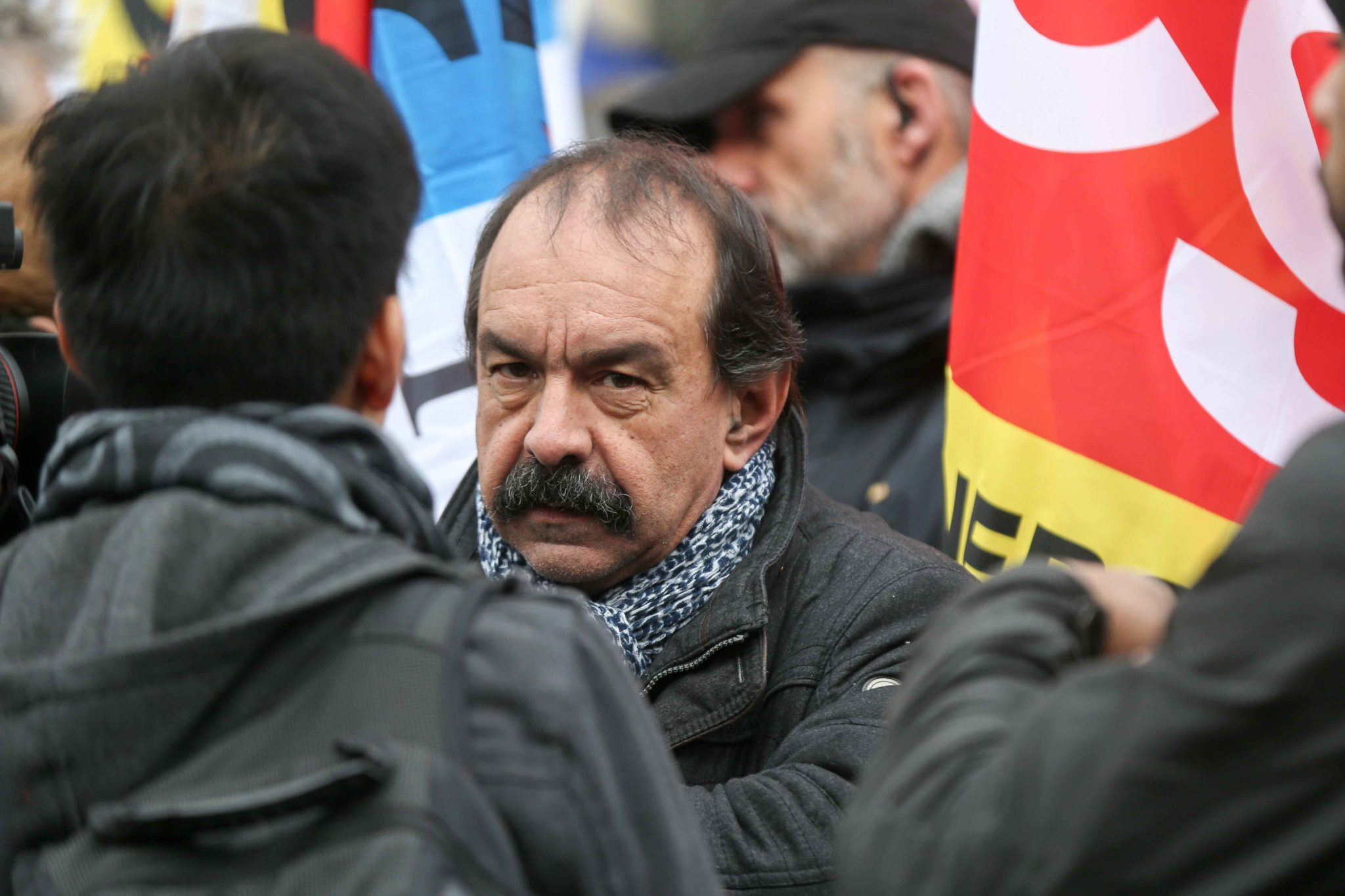CGT union leader Philippe Martinez (C) takes part in a demonstration in Paris, on January 11, 2020, as part of a nationwide multi-sector strike against the French government's pensions overhaul. The country has been hit by 37 days of crippling train and me