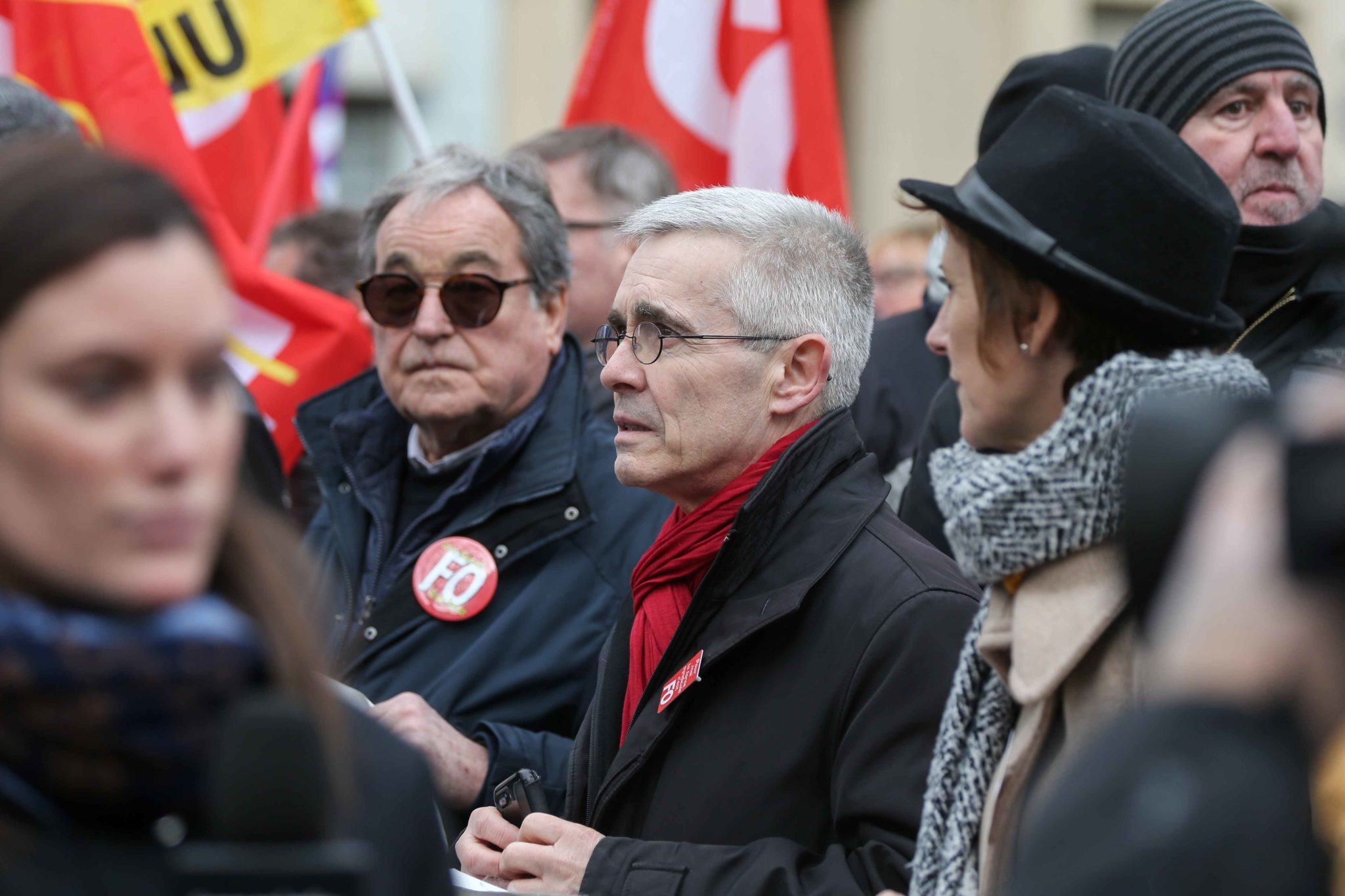 General secretary of French Union Force Ouvriere (FO) Yves Veyrier (C) takes part in a demonstration in Paris, on January 11, 2020, as part of a nationwide multi-sector strike against the French government's pensions overhaul. The country has been hit by 3