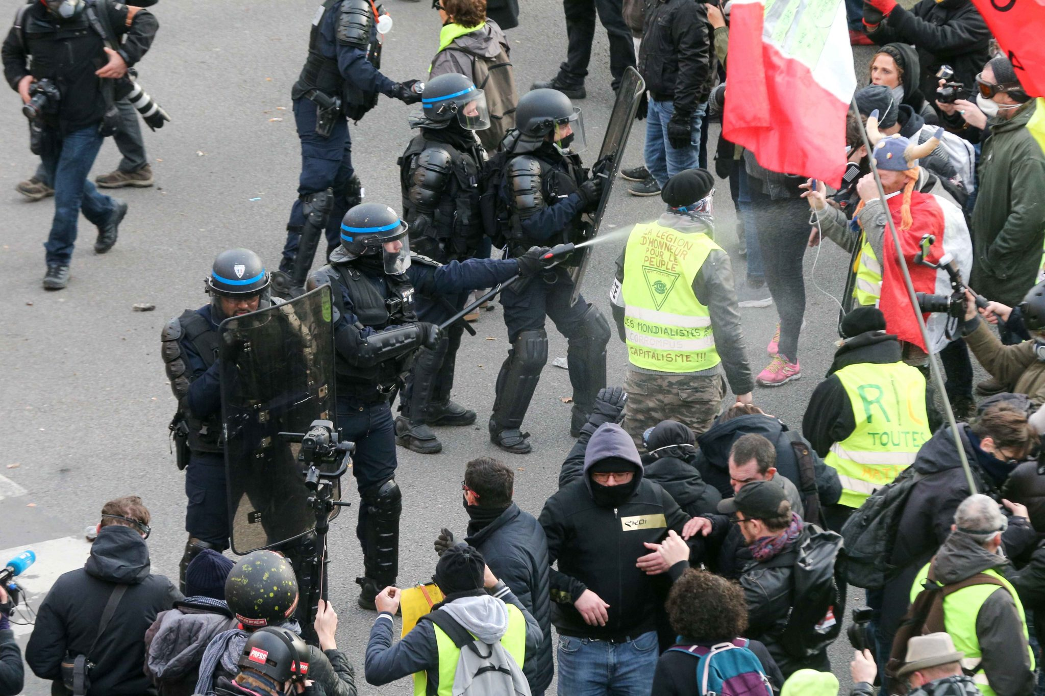 Protesters clash with riot police officers during a demonstration in Paris, on January 11, 2020, as part of a nationwide multi-sector strike against the French government's pensions overhaul. The country has been hit by 37 days of crippling train and metro