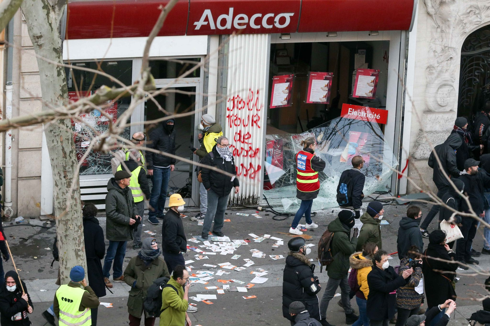 The windows of an Adecco interim agency are brocken during a demonstration in Paris, on January 11, 2020, as part of a nationwide multi-sector strike against the French government's pensions overhaul. The country has been hit by 37 days of crippling train