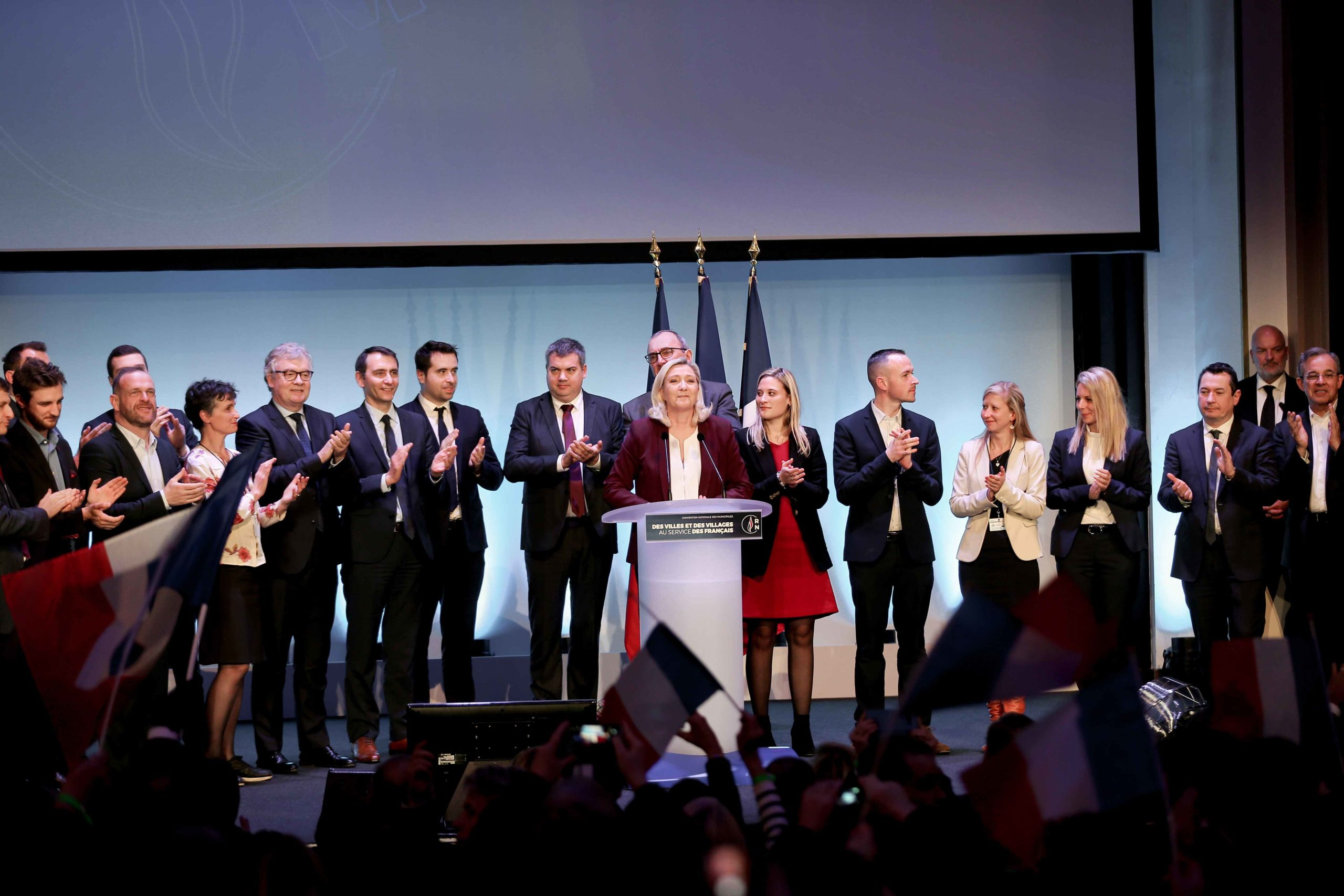French far-right party Rassemblement National (RN) president and MP Marine Le Pen (C) speaks in Paris, on January 12, 2020, during a meeting to launch the RN campaign candidates for the next municipal elections.  The 2020 French municipal elections will be