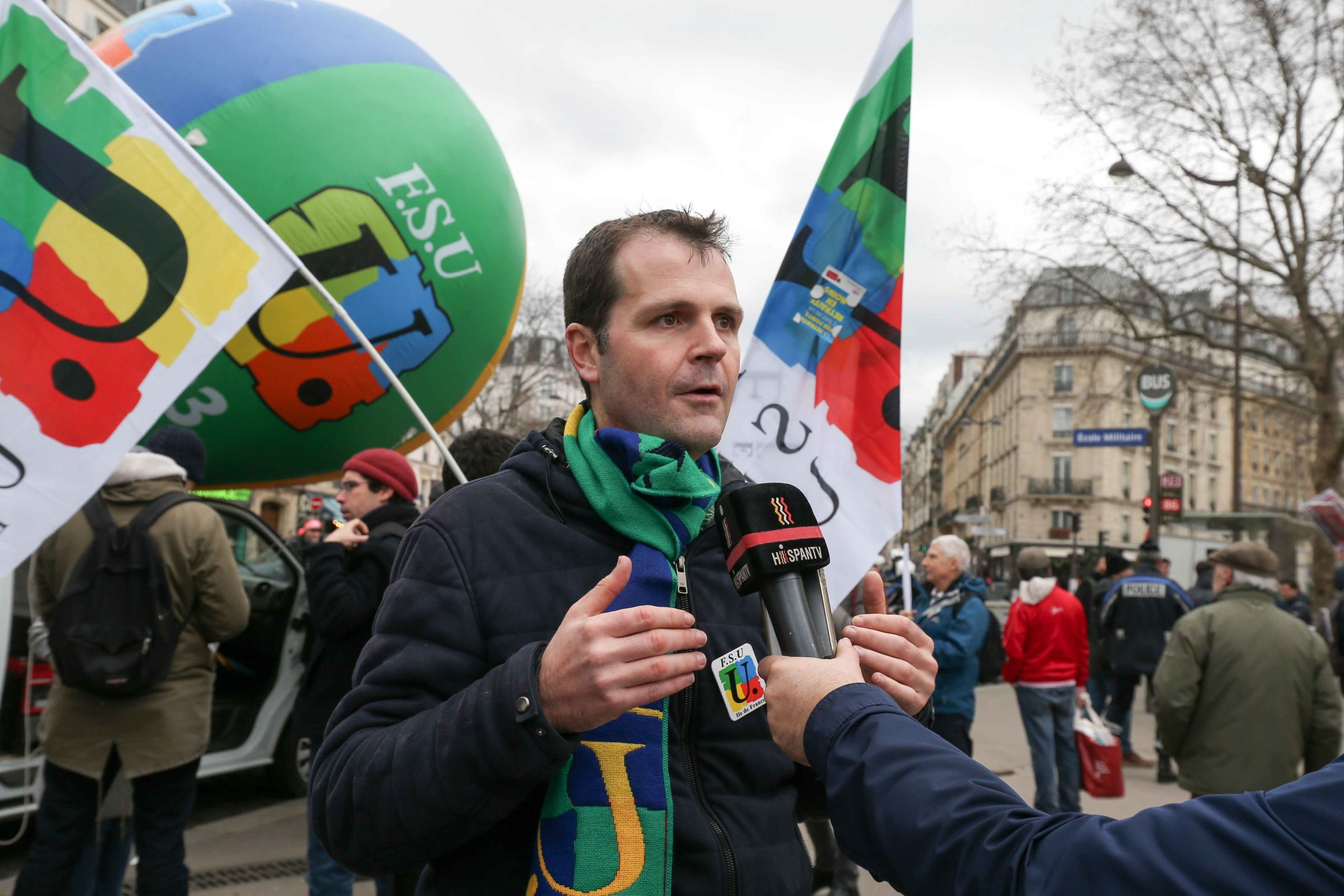 French FSU union leader Benoit Teste talk with the press during a demonstration in Paris on January 14, 2020, as part of a nationwide multi-sector strike against the French government's pensions overhaul.A transport strike dragged on into its 41st day on