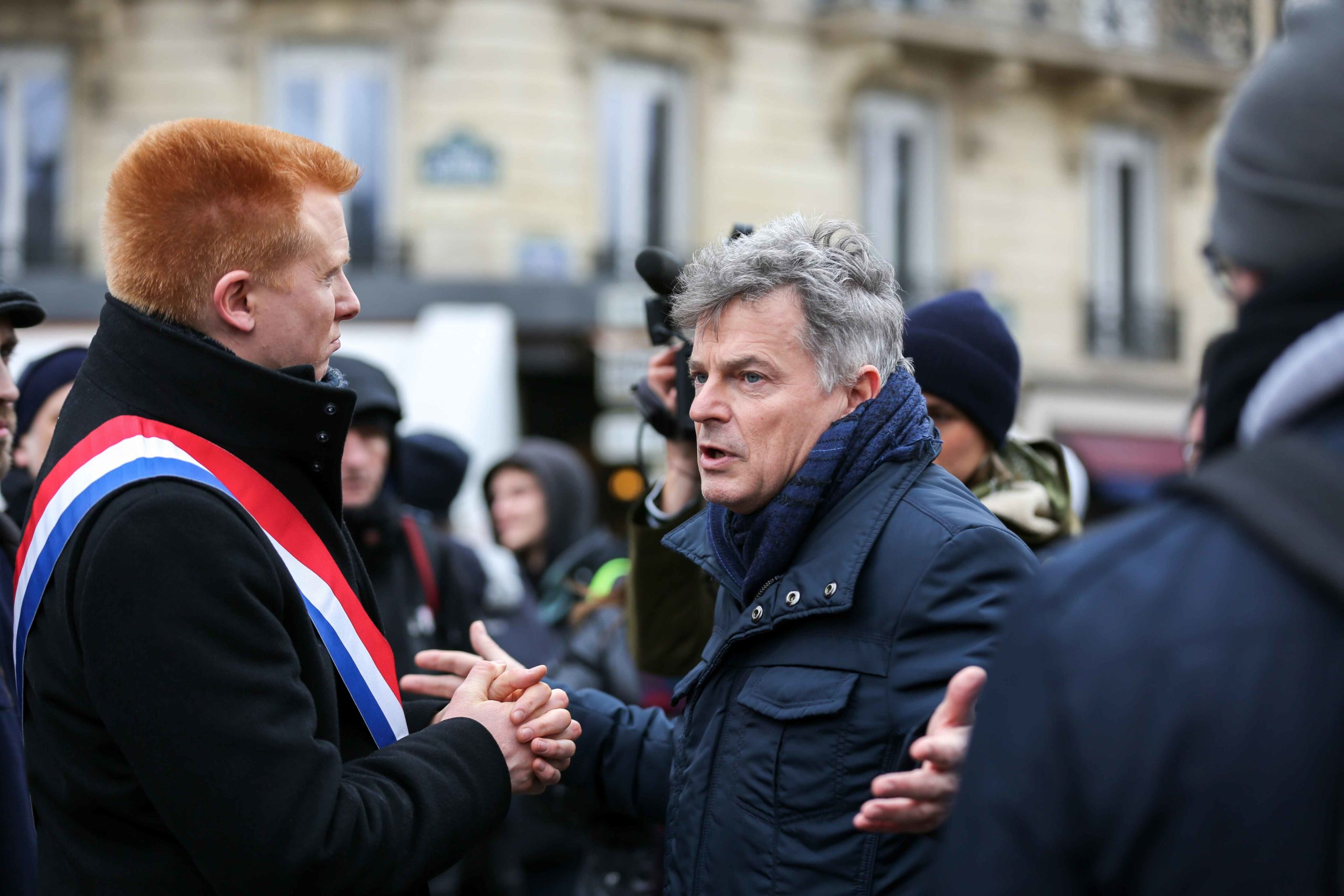 French leftist party La France Insoumise (LFI) MP Adrien Quatennens (L) speaks with Communist party member of Parliament Fabien Roussel (C) as they take part in a demonstration in front the Tour Eiffel in Paris on January 14, 2020, as part of a nationwide