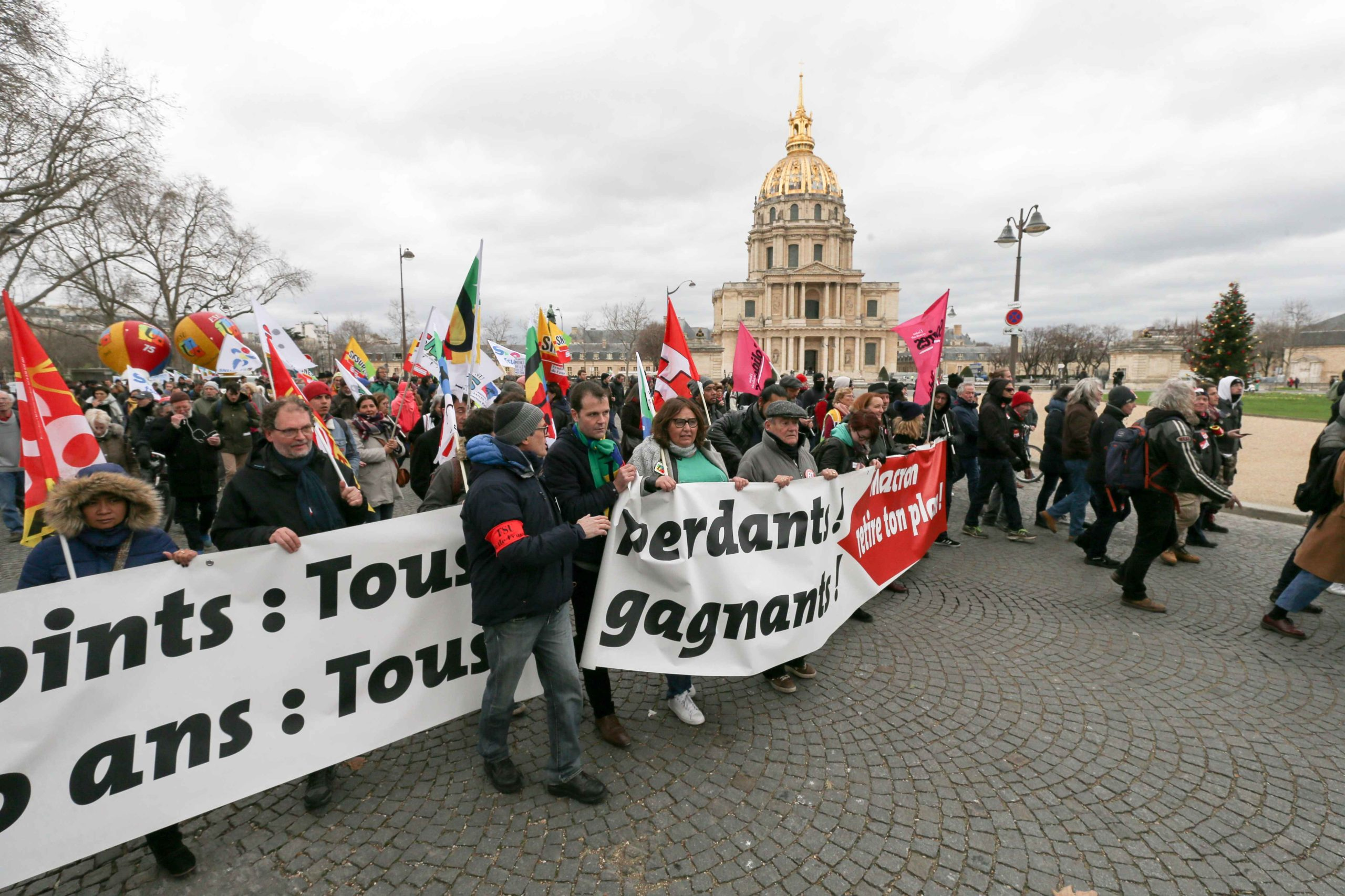 Protesters take part in a demonstration in front the Dôme des Invalides in Paris on January 14, 2020, as part of a nationwide multi-sector strike against the French government's pensions overhaul.A transport strike dragged on into its 41st day on January