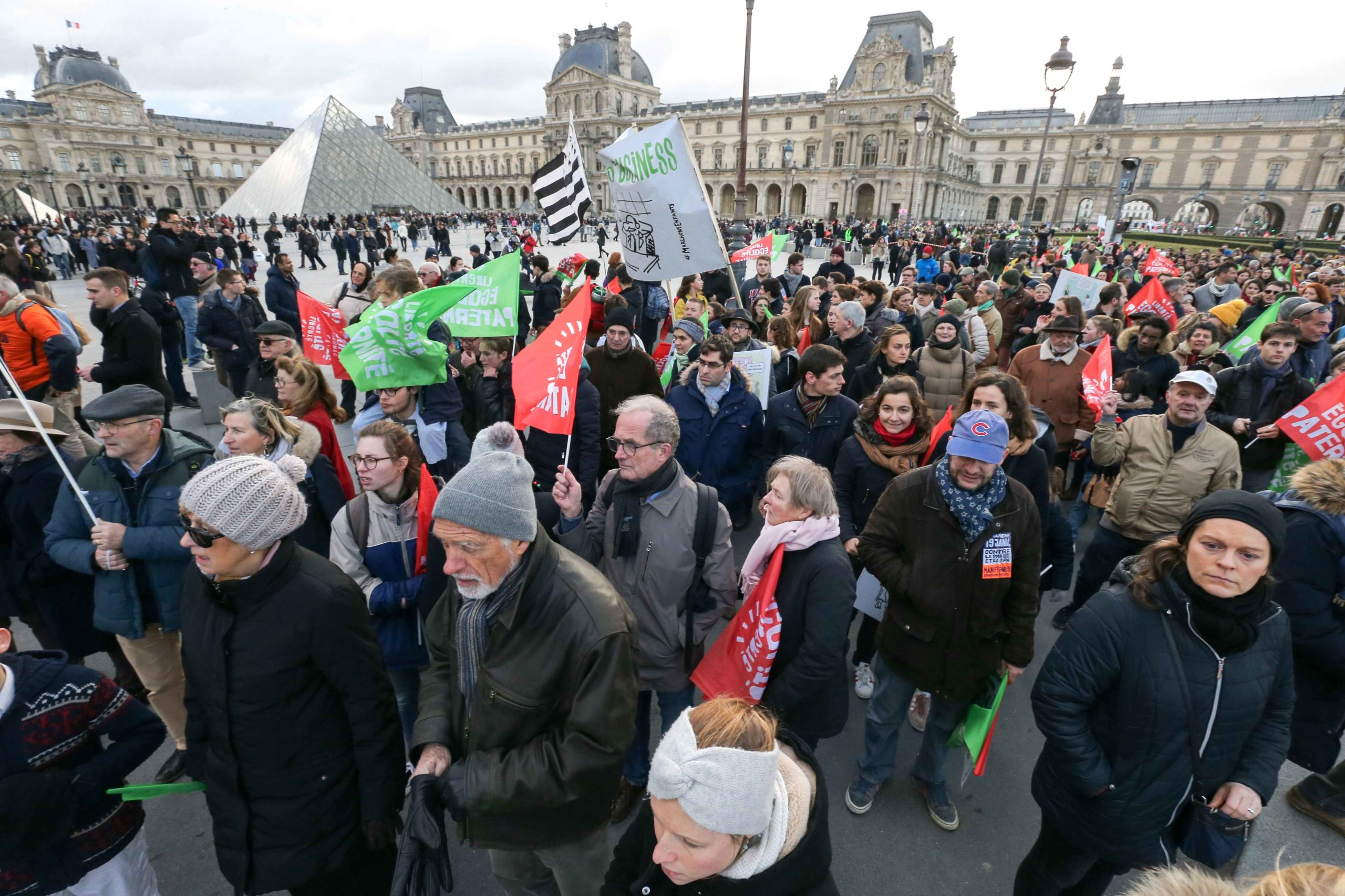 "Protesters hold flags in front of the Louvre Museum during a demonstration called by the movement 'La Manif pour tous' against the ""Medically-assisted procreation (MAP) without a father"" in Paris on January 19, 2020, two days before the debate on the Bioet"
