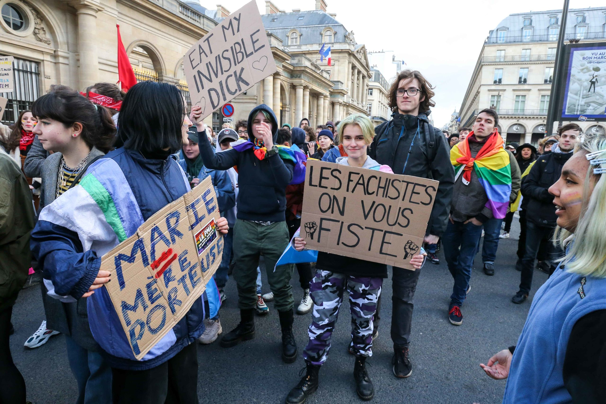 "Counter-demonstrators holding placards gather during a demonstration called by the movement 'La Manif pour tous' against the ""Medically-assisted procreation (MAP) without a father"" in Paris on January 19, 2020, two days before the debate on the Bioethics B"