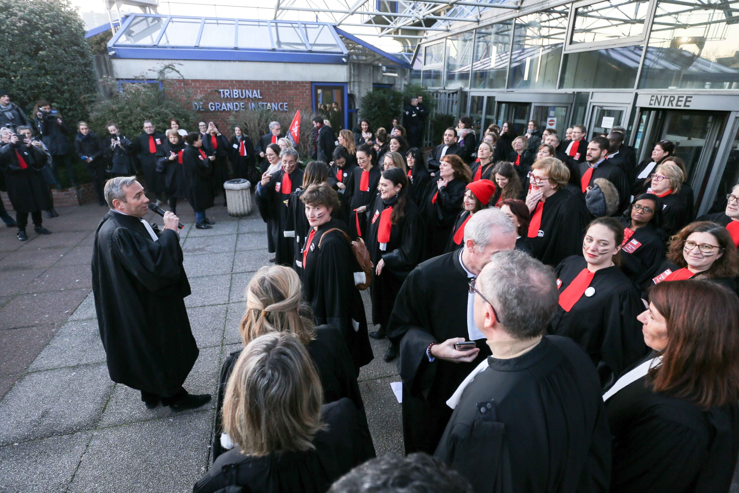 A dozen of lawyers and from the avocature, made an action on the square of the high court of Bobigny, France, the tGI, on 22 January 2020, to protest against the pension reform of the governement. They sang some song, made a rugby Aka, to show their anger.