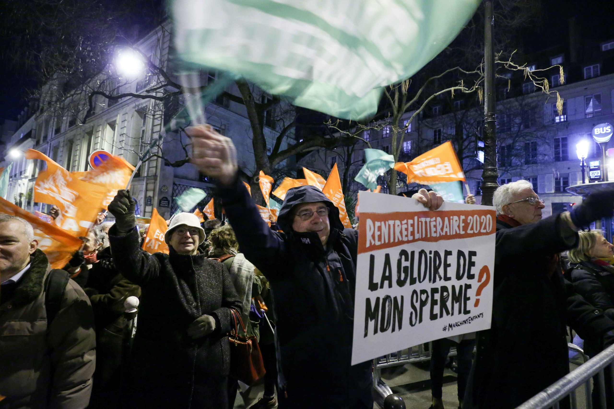 "People wave flags during a demonstration against ""medically-assisted procreation without a father"" (PMA - Procreation Medicalement Assistee) in front of the Senat in Paris on January 22, 2020, as the debate on the Bioethics Bill began. The Senate began on"