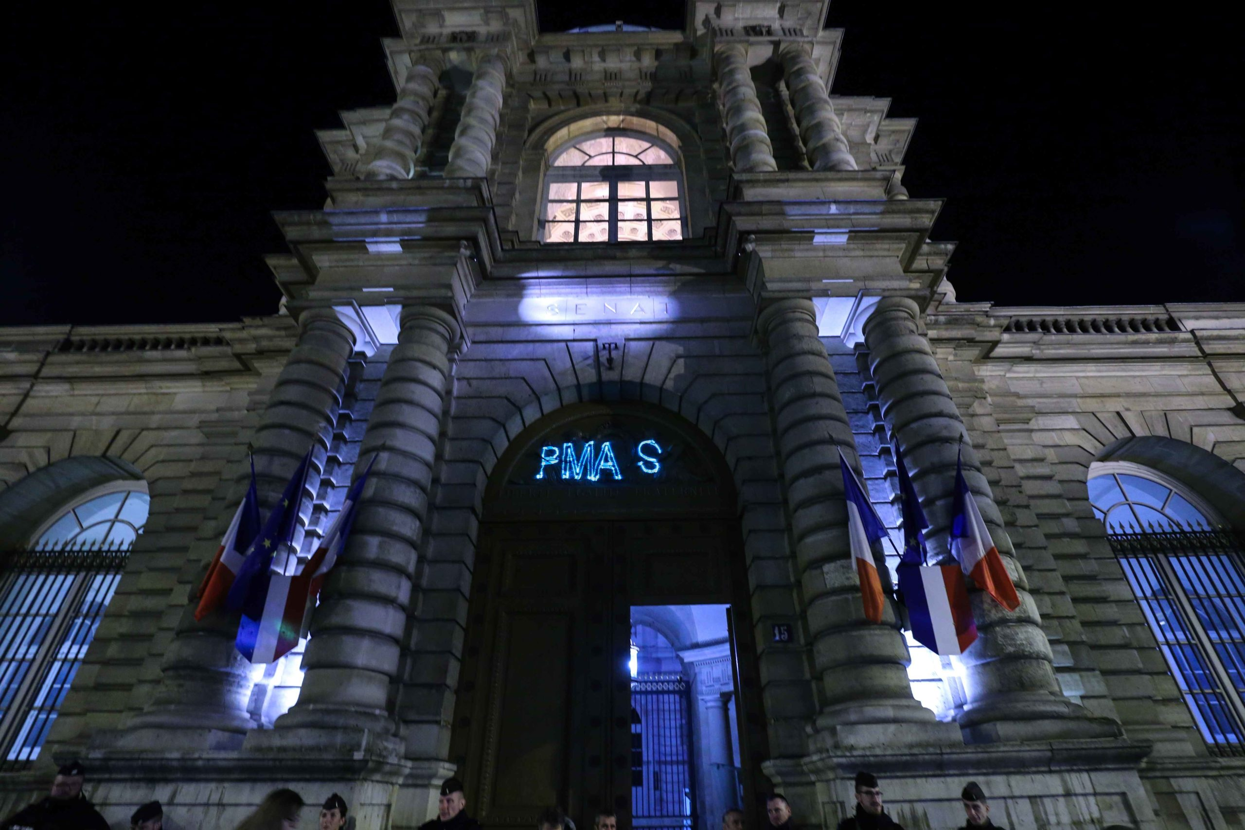 "A laser writes the words « No to PMA » on the Sénat during a demonstration against ""medically-assisted procreation without a father"" (PMA - Procreation Medicalement Assistee) in front of the Senat in Paris on January 22, 2020, as the debate on the Bioet"