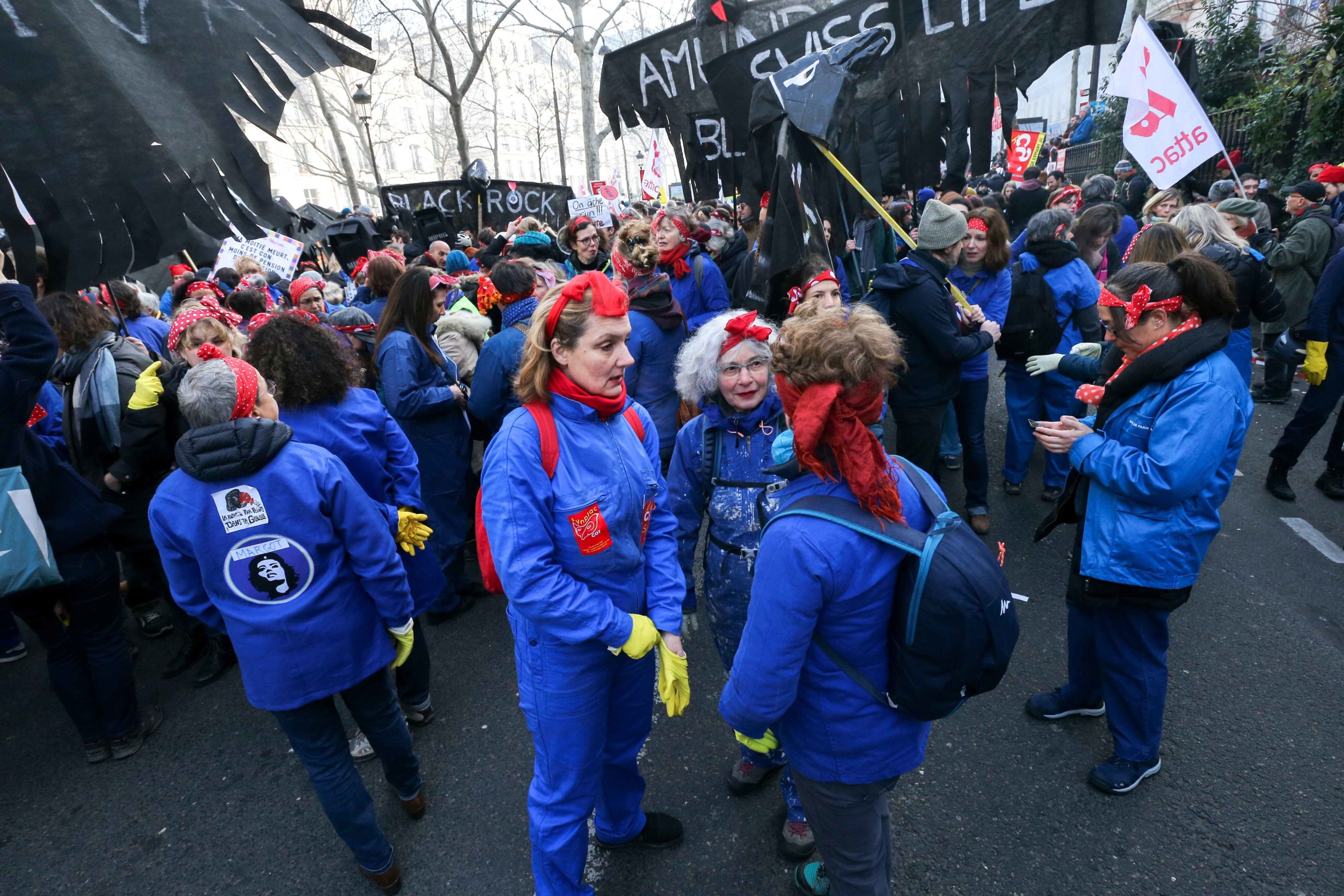 Feminist activists dressed as traditional cleaners take part in a demonstration in Paris on January 24, 2020 during against the government pensions reform, which will be officially unveiled after weeks of strikes by unions warning that millions of people w