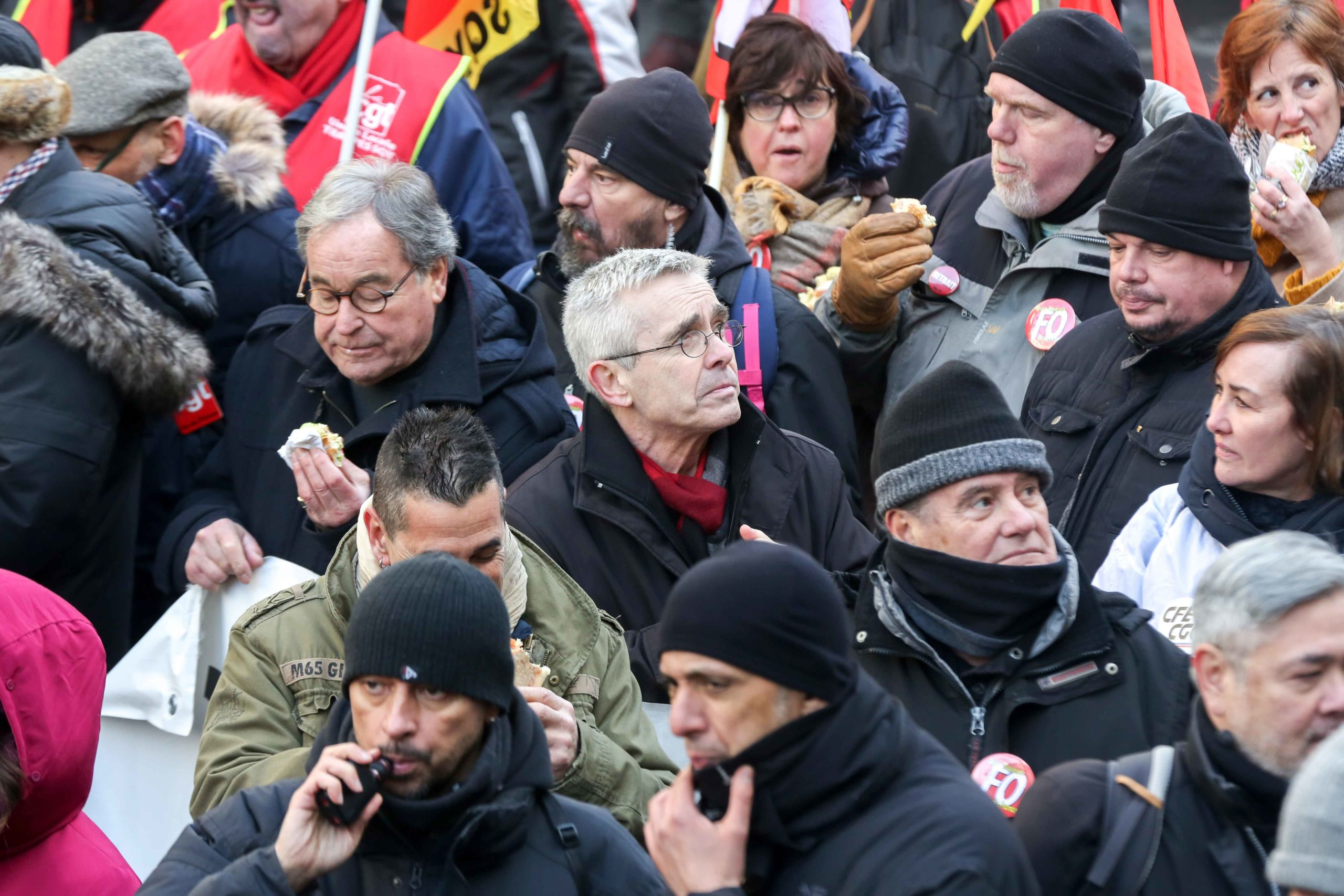 General secretary of French Union Force Ouvriere (FO) Yves Veyrier (C) takes part in a demonstration in Paris on January 24, 2020 during against the government pensions reform, which will be officially unveiled after weeks of strikes by unions warning that